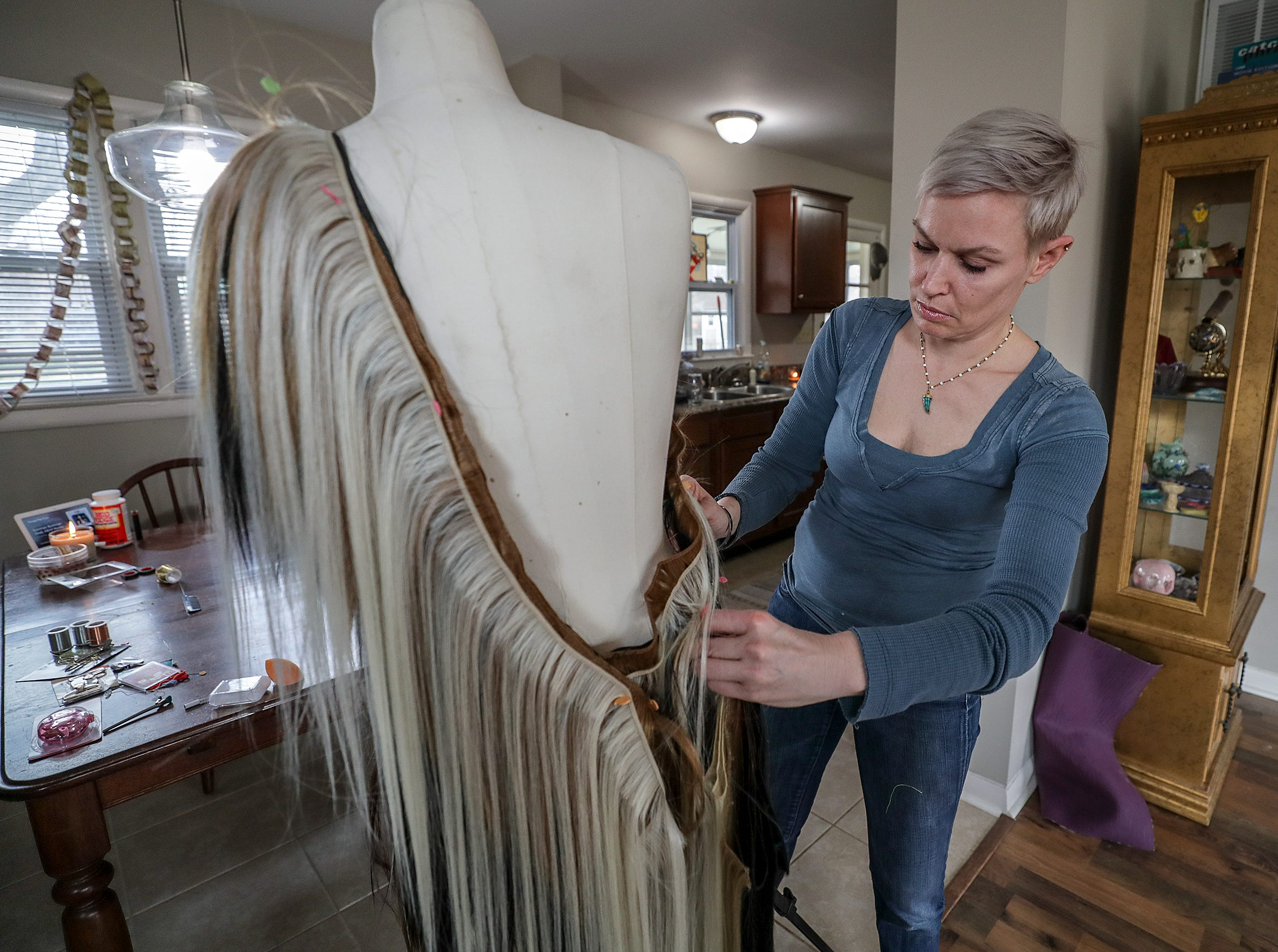 Karen Stout, a master stylist with Joseph Salon and Spa, has created a dress for Kentucky Museum of Art and Craft (KMAC) Couture Fashion Week.  The dress is made of half human hair and half synthetic hair.