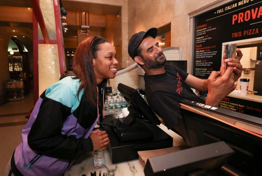 Asia Durr found some fans in New York City ahead of the WNBA draft. Here, she takes a selfie with Hasan Daud while ordering lunch at Prova Pizza before attending the draft. April 10, 2019