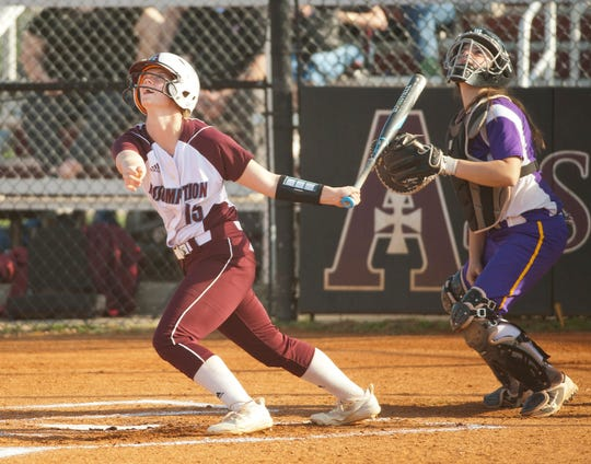 Assumption's Sydney Young and Male catcher Lilly Davis follow the arc of Young's  fly ball.10 April 2019