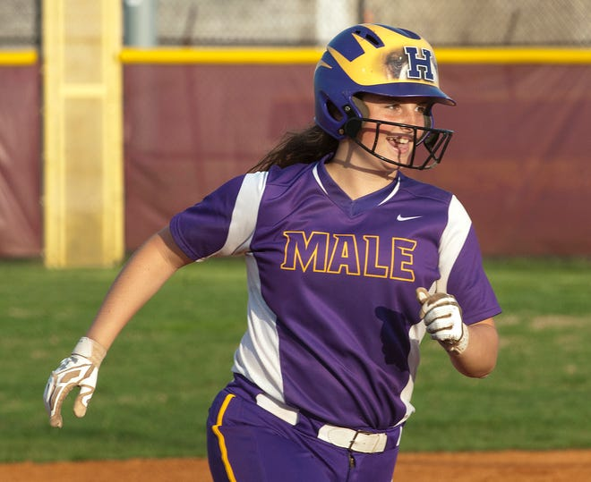 Male's Lilly Davis turns third base and heads for home after hitting a home run over the left field fence.10 April 2019