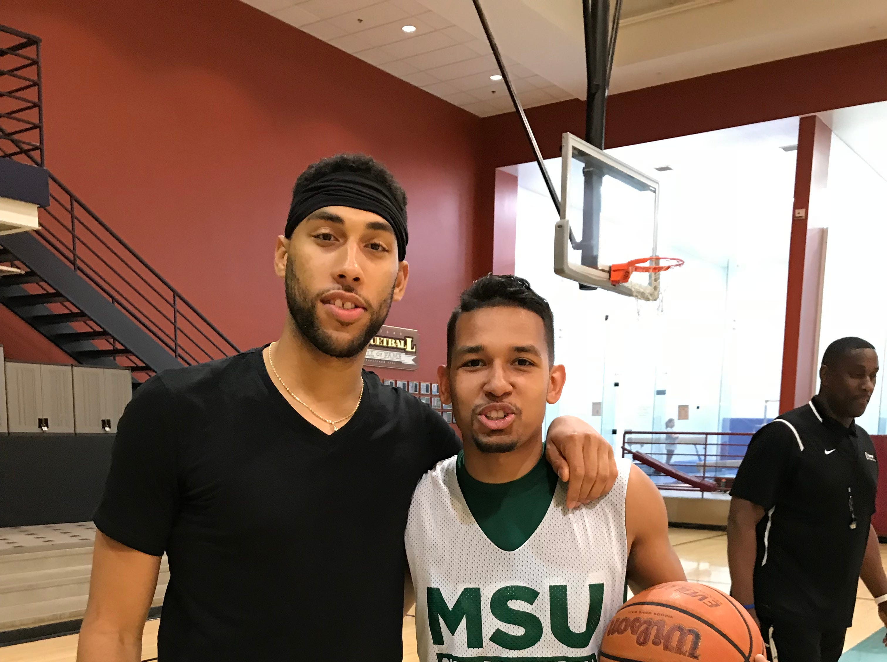 Denzel Valentine and Robert Ray Jr. were members of the state champion Sexton High School basketball team in 2011.