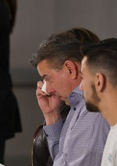 David Kowalski, father of Bailey Kowalski, wipes tears from his eyes as his daughter, an MSU senior,  talks about being sexually assaulted by three former Michigan State University basketball players. The attack happened the evening of April 11, 2015, and the morning of April 12, 2015. [USA TODAY NETWORK/MATTHEW DAE SMITH/Lansing State Journal]