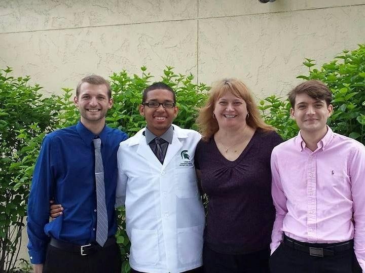 Josh Barber-Braun, Robert Ray Jr., Lori Barber and Michael Barber-Braun pose for a photo for Ray's white coat ceremony in June of 2015.