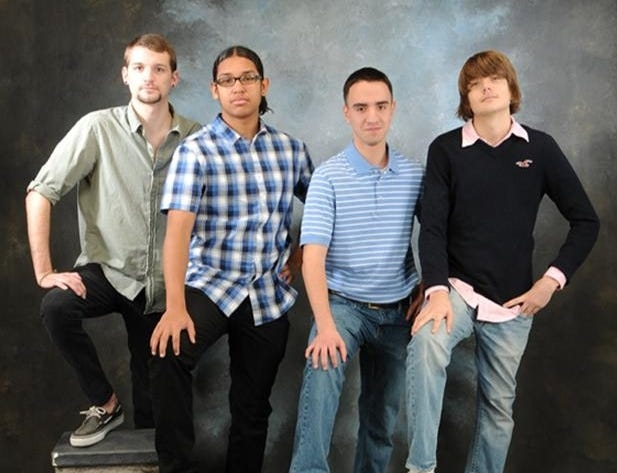 A senior portrait featuring Josh Barber-Braun, Robert Ray Jr., Antonio Barrera and Michael Barber-Braun.