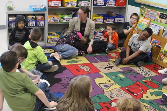 Kathy Butler, an Educational Support Specialist at McKinley Elementary School  listens to a group of second graders Wednesday morning. She usually visits around five classrooms a day helping students develop coping mechanisms.