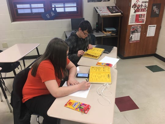 Harding students use resources such as historical editions of the Harding Herald and Marion Star to dig into local history in a popular social studies class.