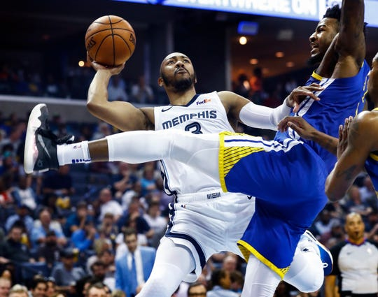 new style 66593 5827c Memphis Grizzlies guard Jevon Carter (left) is fouled by Golden State  Warriors defender Jordan