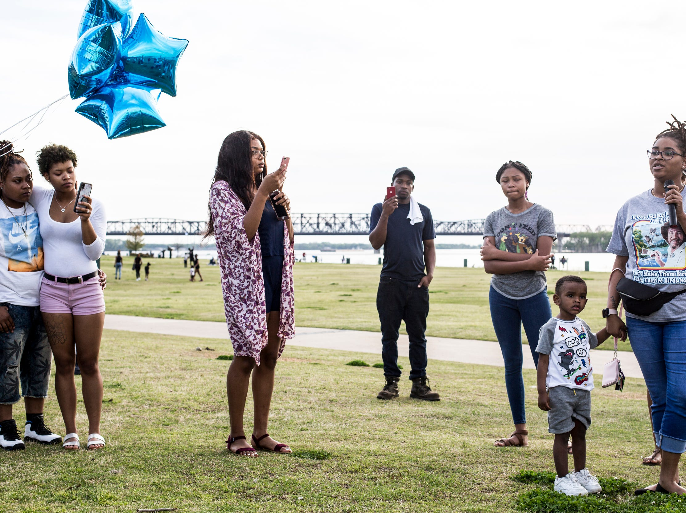 April 10, 2019 - Osean Bailey, right, with her son, Princeton Sharp, 3, speaks during a vigil in honor of Nipsey Hussle at Tom Lee Park on Wednesday evening. Nipsey Hussle, a Grammy-nominated rapper and businessman, was shot to death in front of his clothing store Los Angeles.