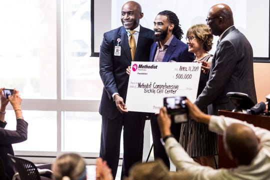 April 11, 2019 - Memphis Grizzlies guard Mike Conley, second from left, poses for a photo after donating $500,000 to the Methodist Healthcare Comprehensive Sickle Cell Center. Conley helped make the announcement alongside Methodist executives on Thursday at Methodist University Hospital, where the center is located.