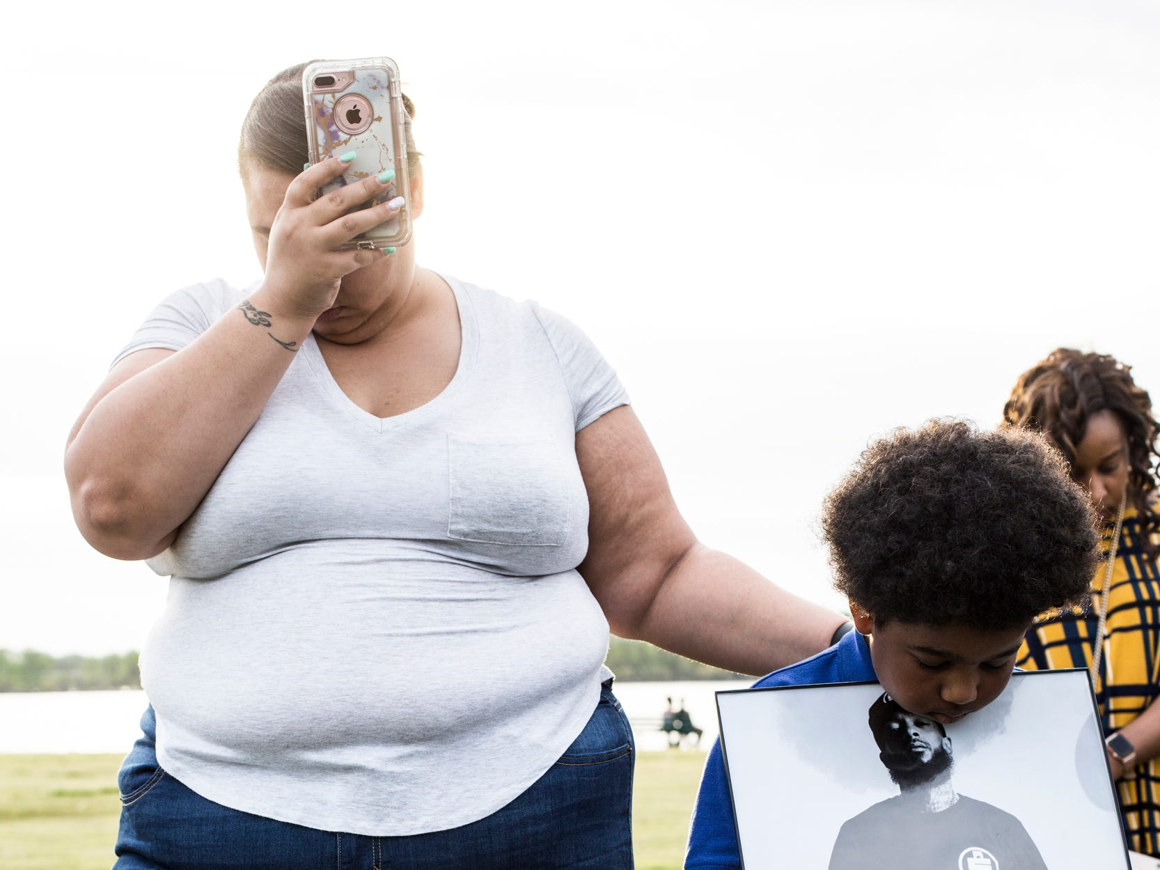 April 10, 2019 - Latisha Brownlee, left, and her nephew Christian Hodges, 7, pray during a vigil in honor of Nipsey Hussle at Tom Lee Park on Wednesday evening. Nipsey Hussle, a Grammy-nominated rapper and businessman, was shot to death in front of his clothing store Los Angeles.
