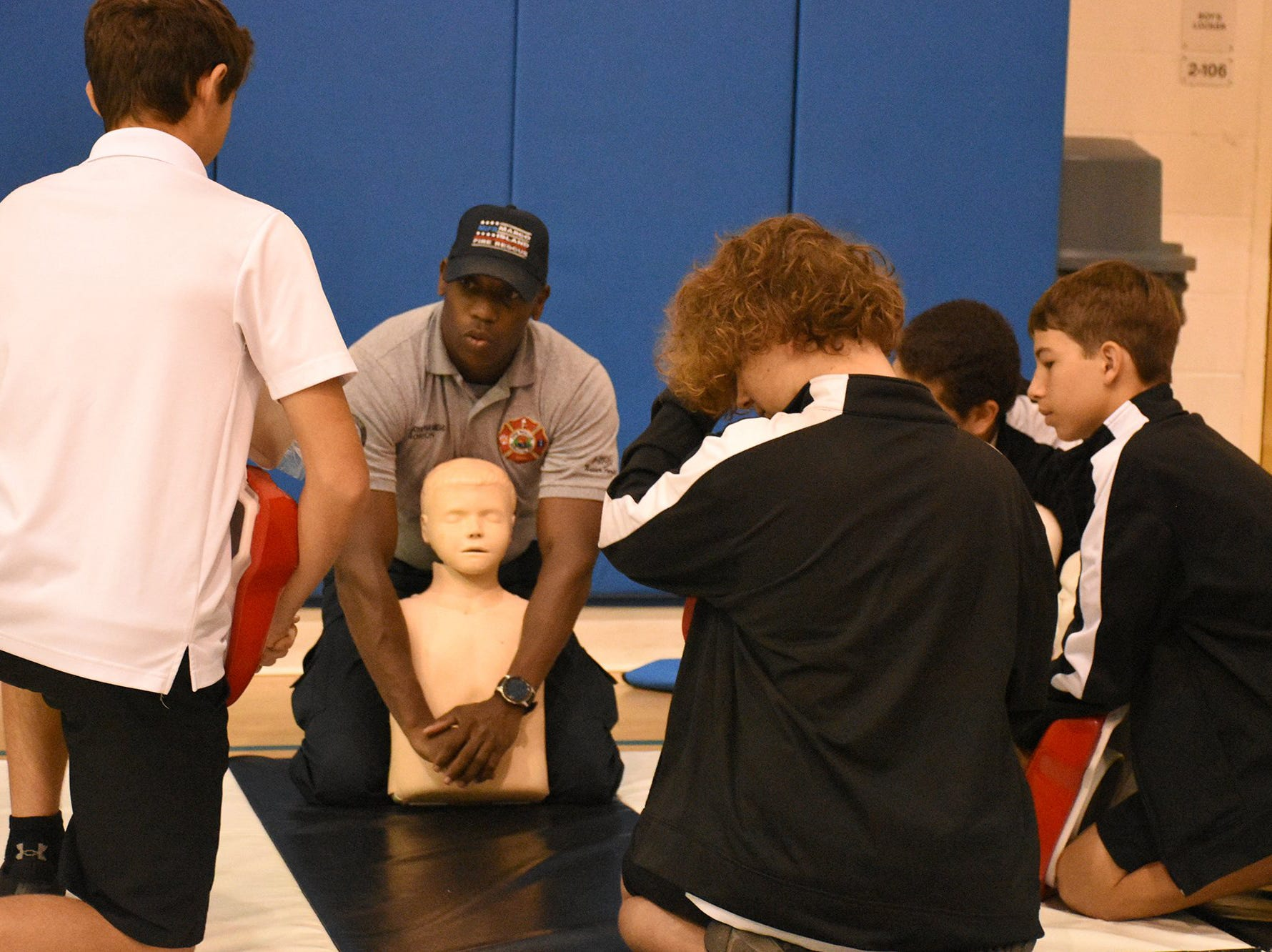 Firefighter/paramedic Tony Gordon demonstrates the Heimlich maneuver for students. The Marco Island Fire-Rescue Dept. trained all eighth graders at MICMS in CPR technique this week.