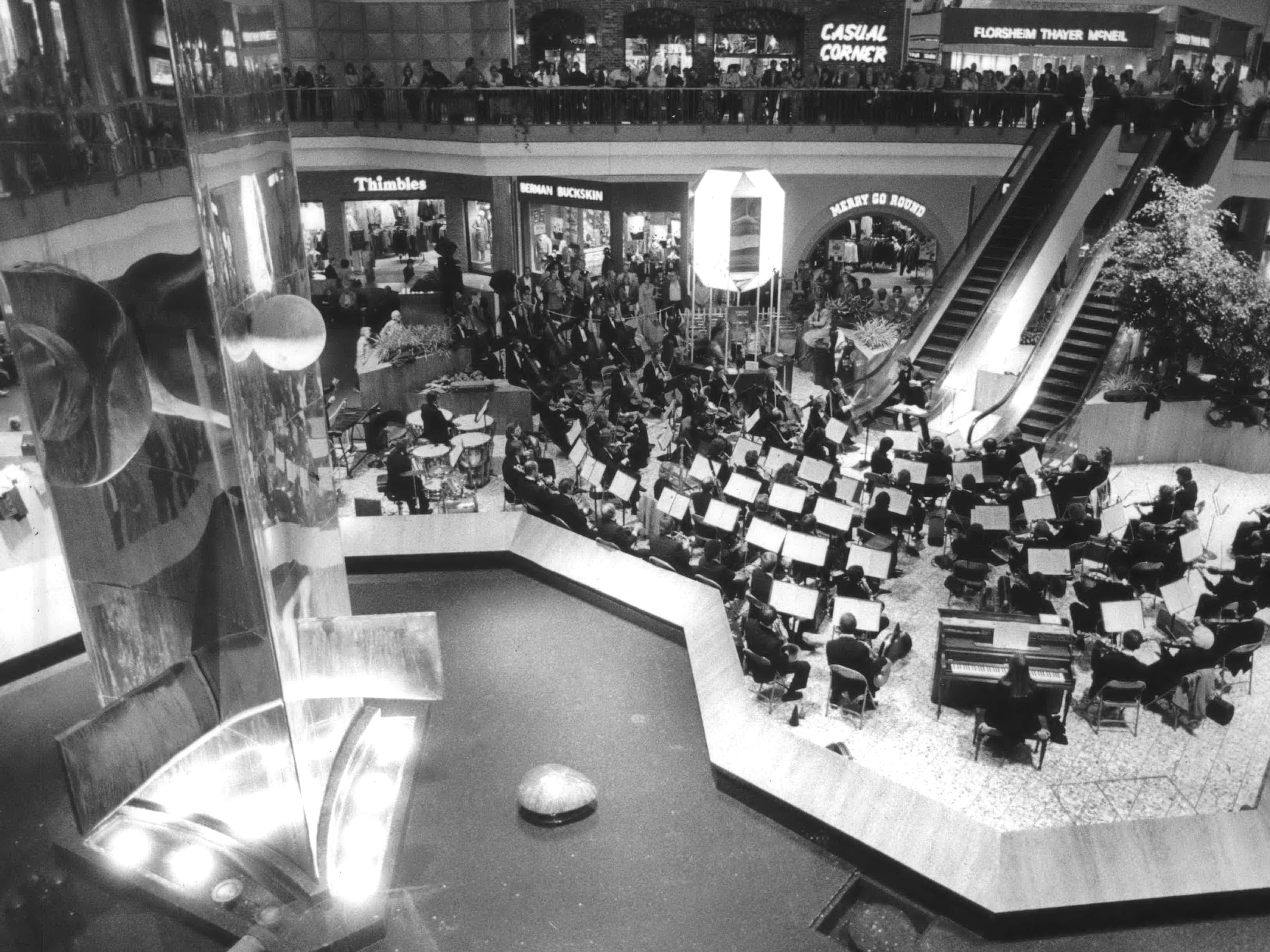 October 1982: Shoppers lined the balcony as the Milwaukee Symphony Orchestra performed Wednesday at the Northridge Shopping Center. The free performance under the direction of associate conductor Paul Polivnick and was part of the center's 10th anniversary celebration.