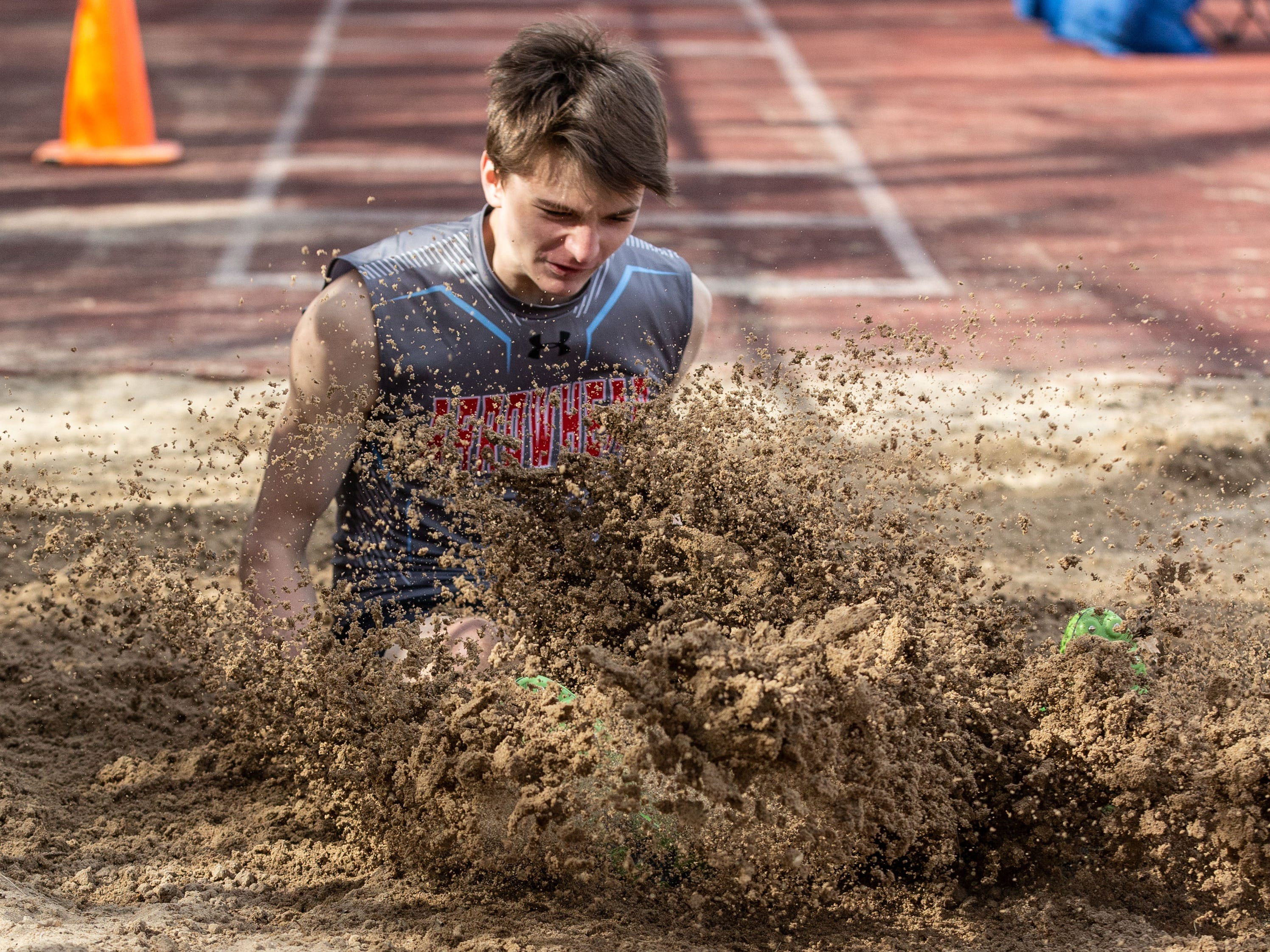 Arrowhead's Zack Graham competes in the long jump during the Mike Gain 50th Annual Spartan Invitational at Brookfield East on Tuesday, April 9, 2019.