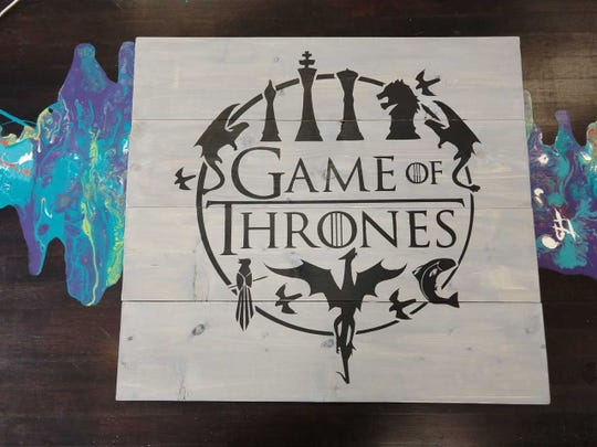 """At Soul Fire Art Studio's """"Game of Thrones"""" gathering May 11, guests can create themed projects like this board art piece."""