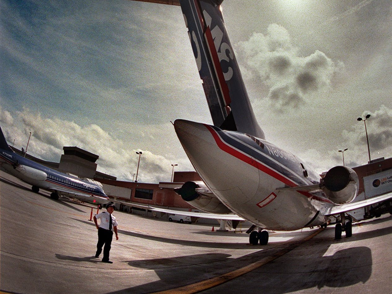 Midwest Express Airlines pilot Michael R. Jilot inspects his aircraft prior to departing for Cleveland, September, 23, 1997 at Mitchell Field.