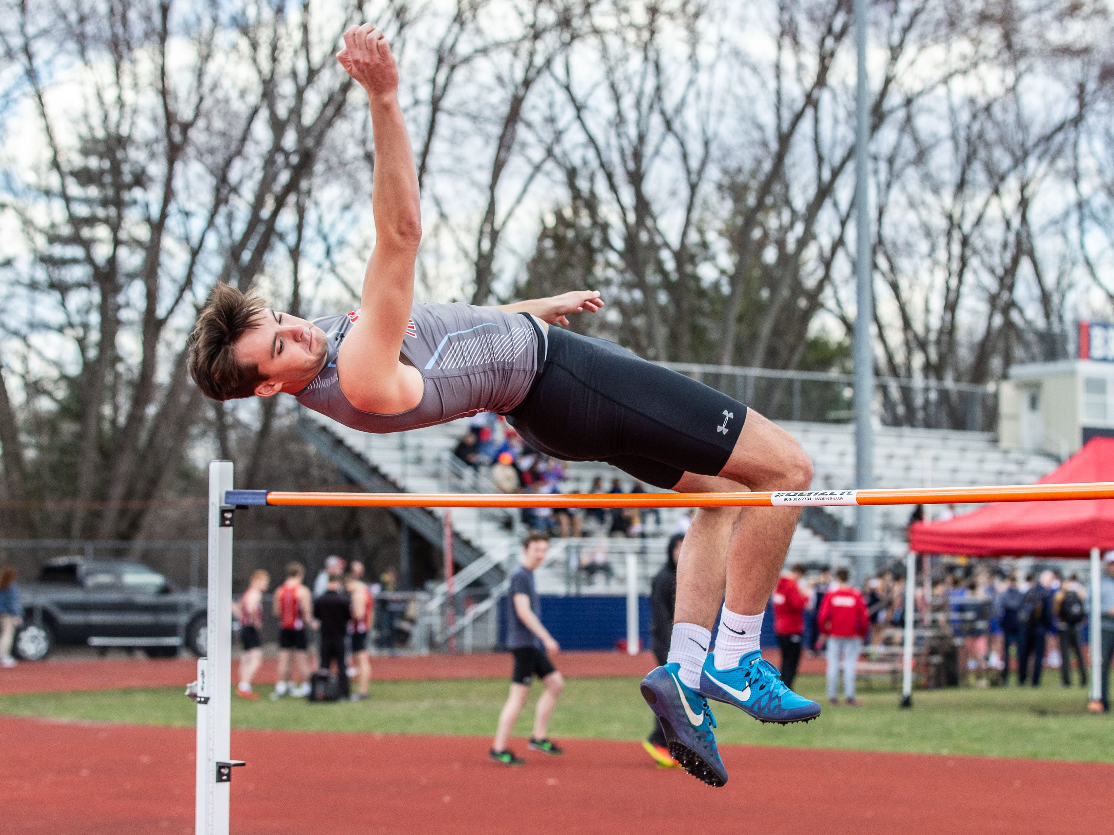 Arrowhead's Jared Lohnes competes in the high jump during the Mike Gain 50th Annual Spartan Invitational at Brookfield East on Tuesday, April 9, 2019.