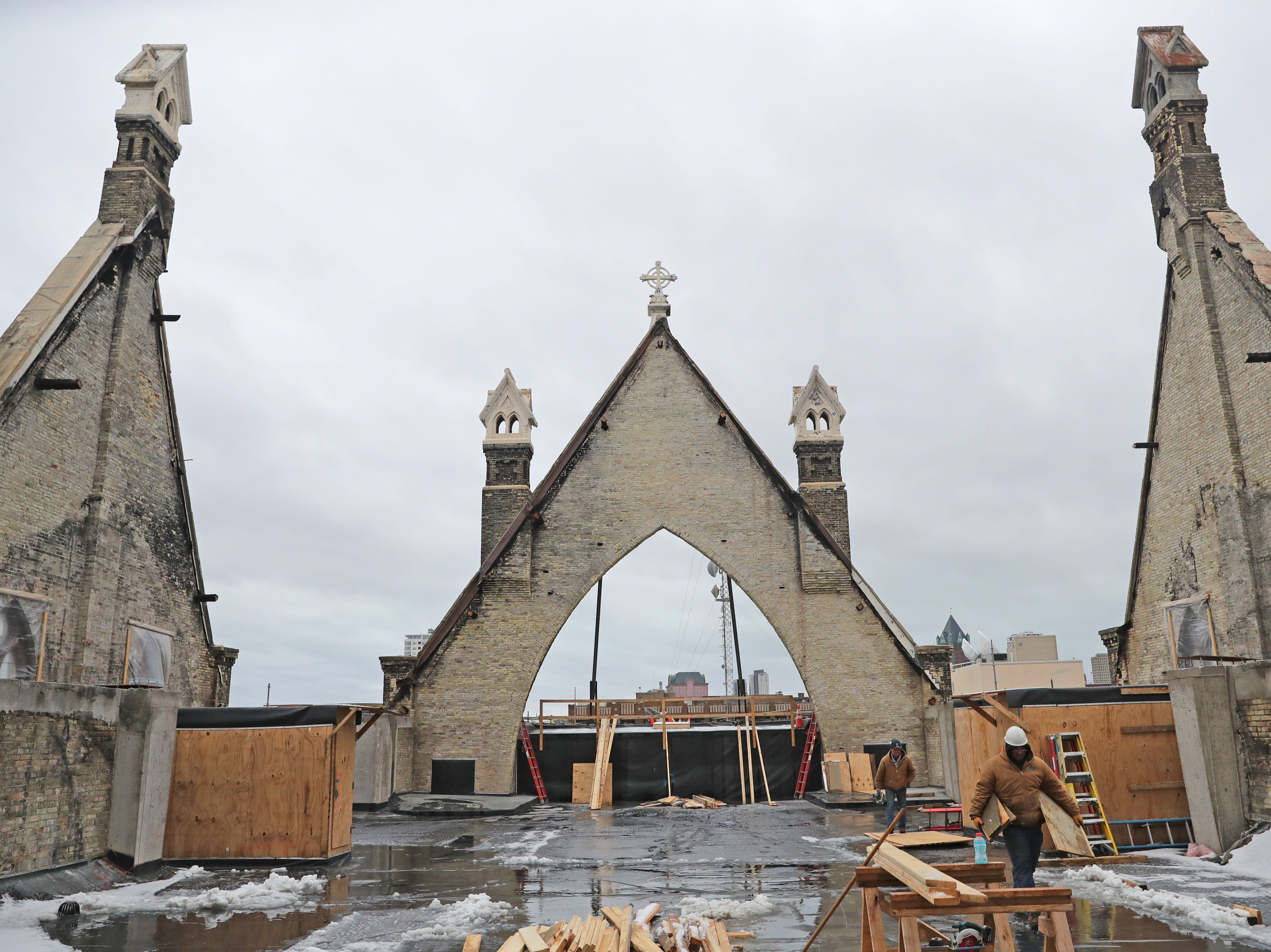 Work is done on the roof area at Trinity Evangelical Lutheran Church. While the exterior structure of the church is being rebuilt to look identical prior to the fire, the interior will be constructed with steel and reinforced concrete rather than wood framing as it formerly was.