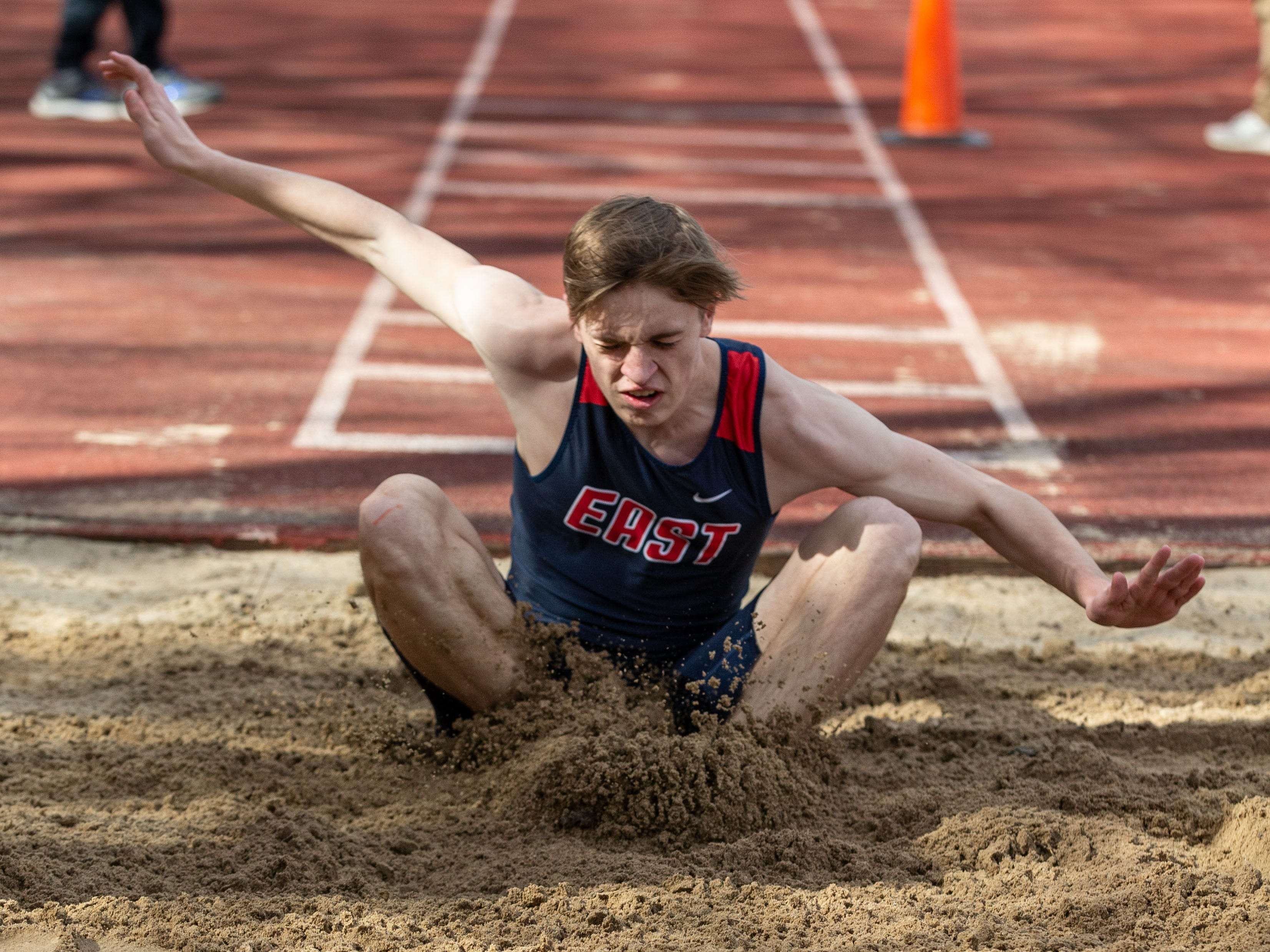 Brookfield East's Riley Mueller competes in the triple jump during the Mike Gain 50th Annual Spartan Invitational at Brookfield East on Tuesday, April 9, 2019.