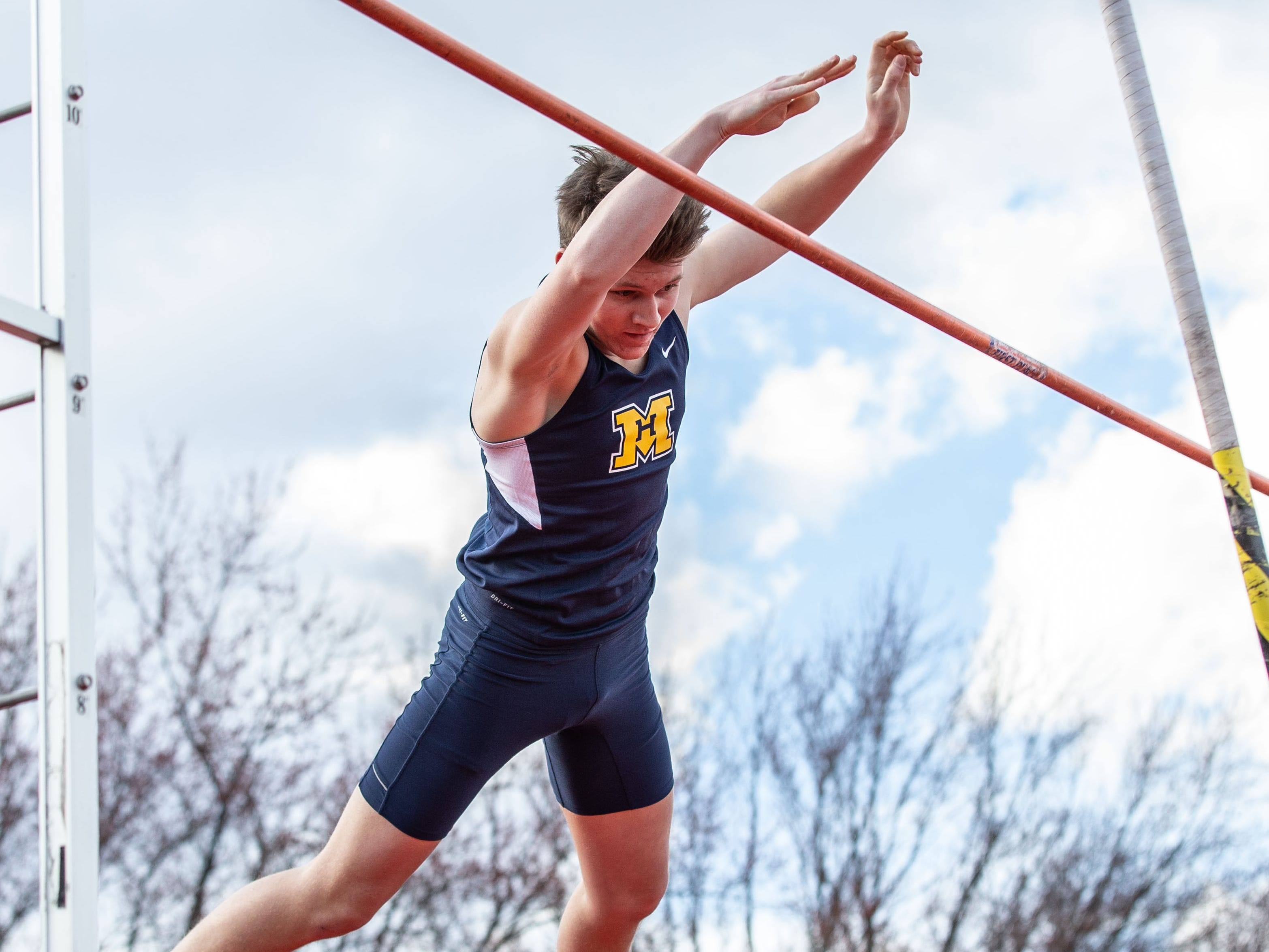 Marquette's Gabe Bohlmann competes in the pole vault during the Mike Gain 50th Annual Spartan Invitational at Brookfield East on Tuesday, April 9, 2019.