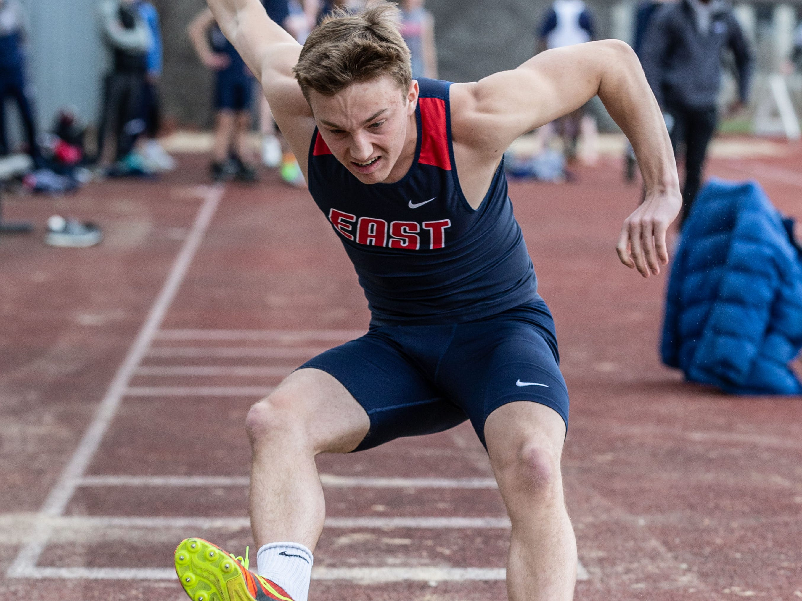 Brookfield East's Owen Herzog competes in the long jump during the Mike Gain 50th Annual Spartan Invitational at Brookfield East on Tuesday, April 9, 2019.