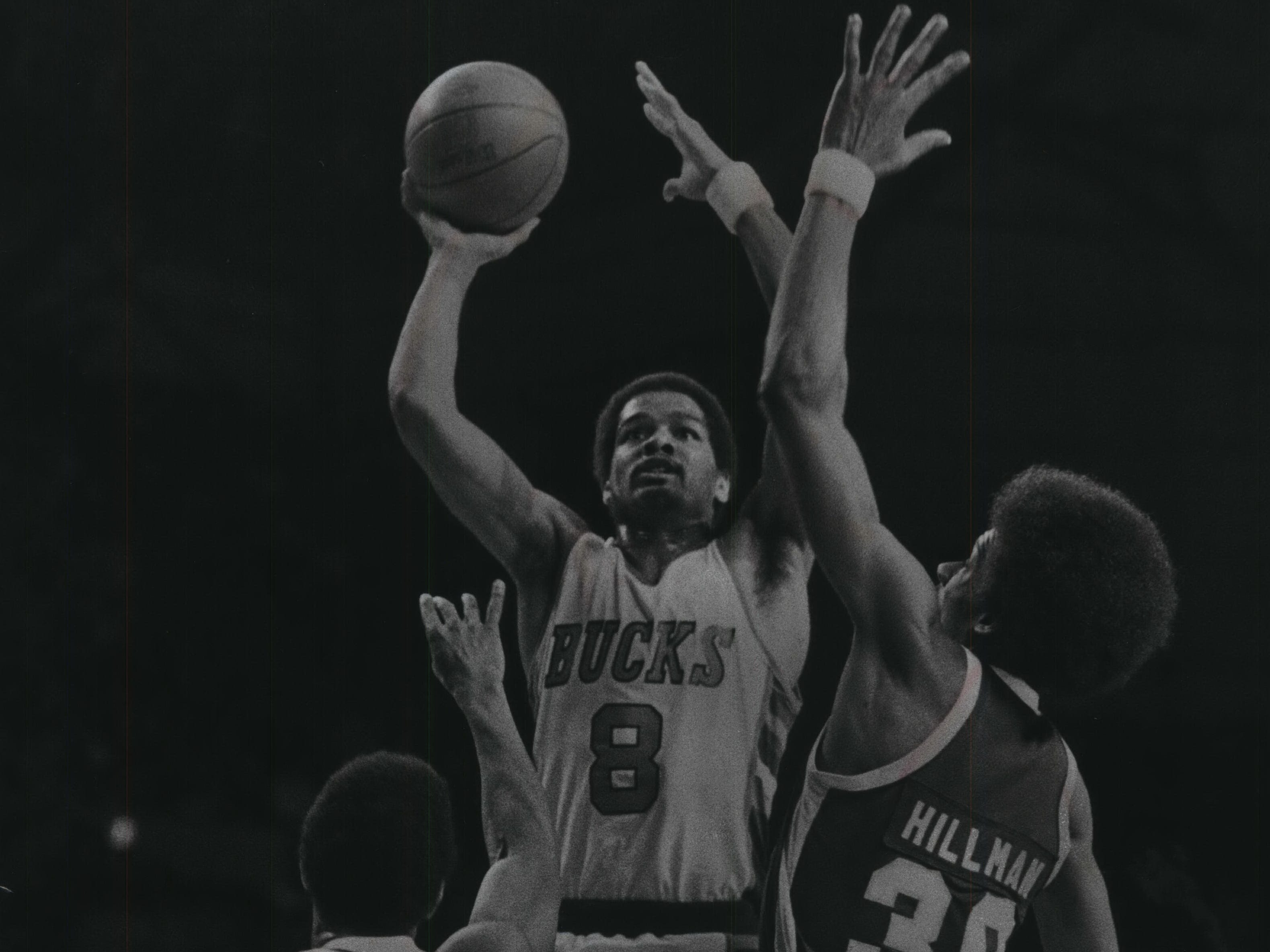 1978: Marques Johnson tries to get off a shot over the Denver Nuggets Anthony Roberts (left) and Darnell Hillman during game four of the Western Conference Semifinals on April 25, 1978. The Nuggets beat the Bucks, 118-104, and held off Milwaukee to win the semifinals in seven games. This photo was published in the April 27, 1978, Milwaukee Sentinel.