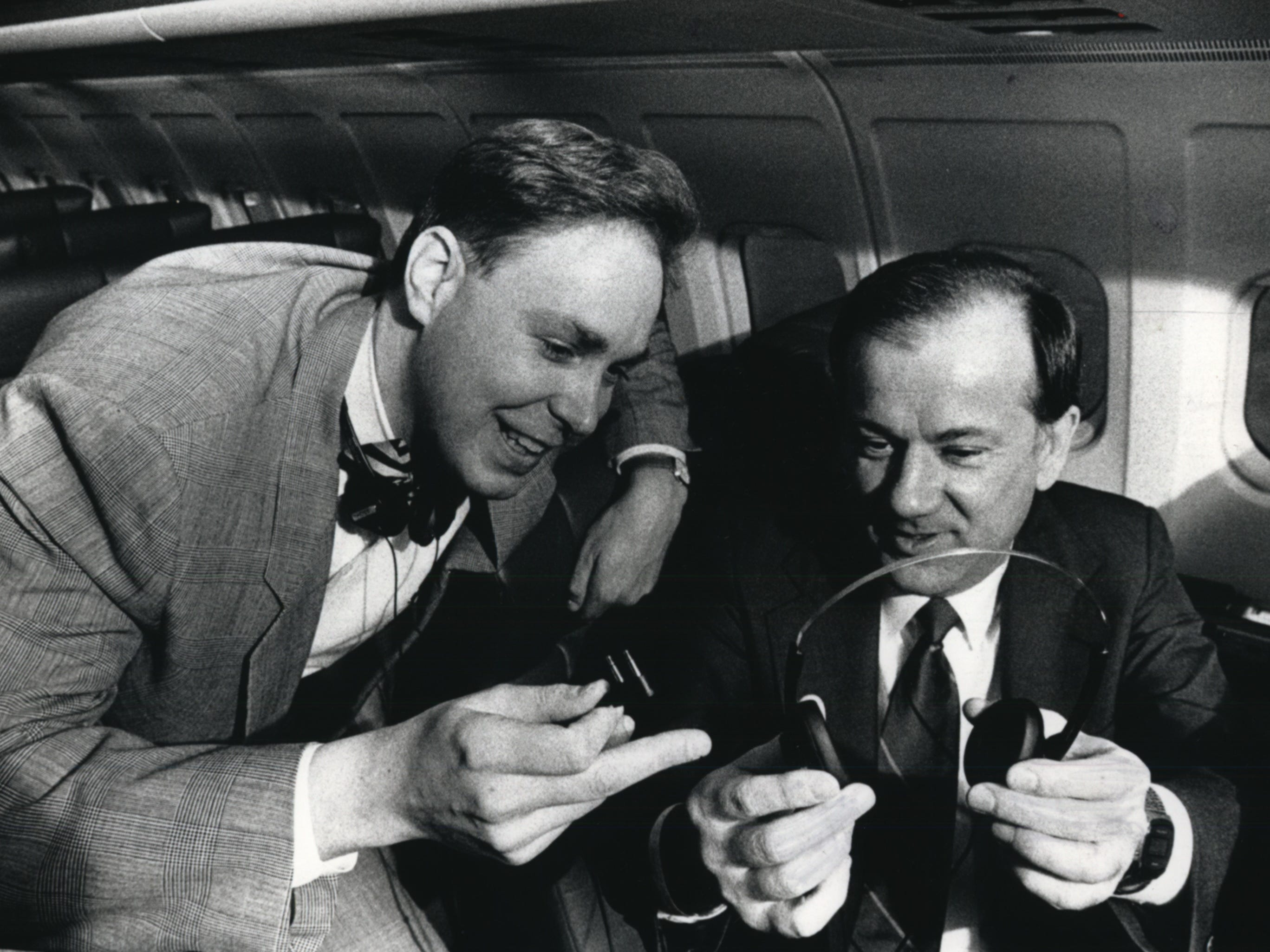 Michael J. Koss (left), president of Koss Corporation, and Timothy E. Koeksema, president of Midwest Express Airlines, examine a pair of Koss TD/30 headphones which were installed on the planes in 1990.