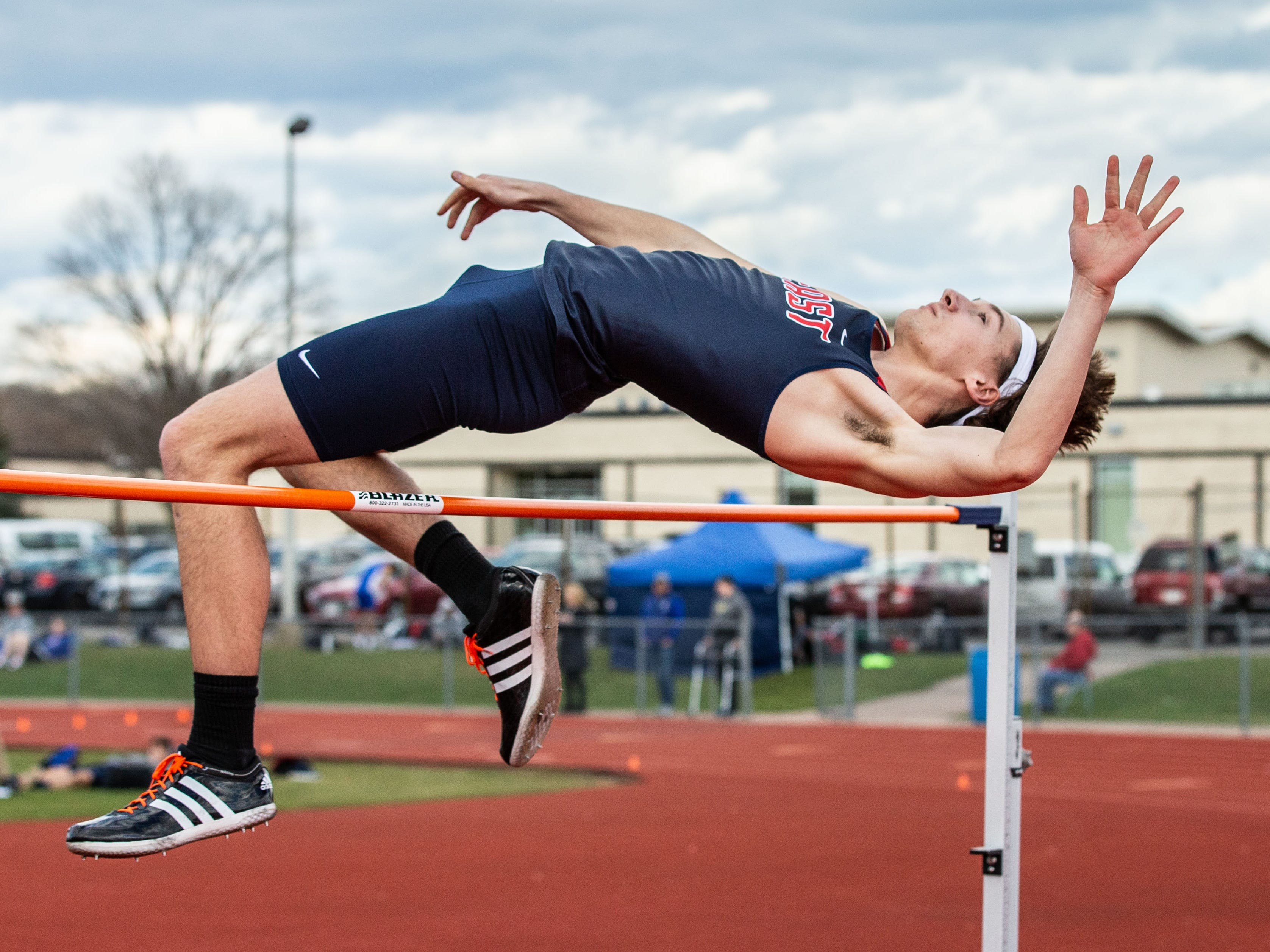 Brookfield East's Jon Szews competes in the high jump during the Mike Gain 50th Annual Spartan Invitational at Brookfield East on Tuesday, April 9, 2019.