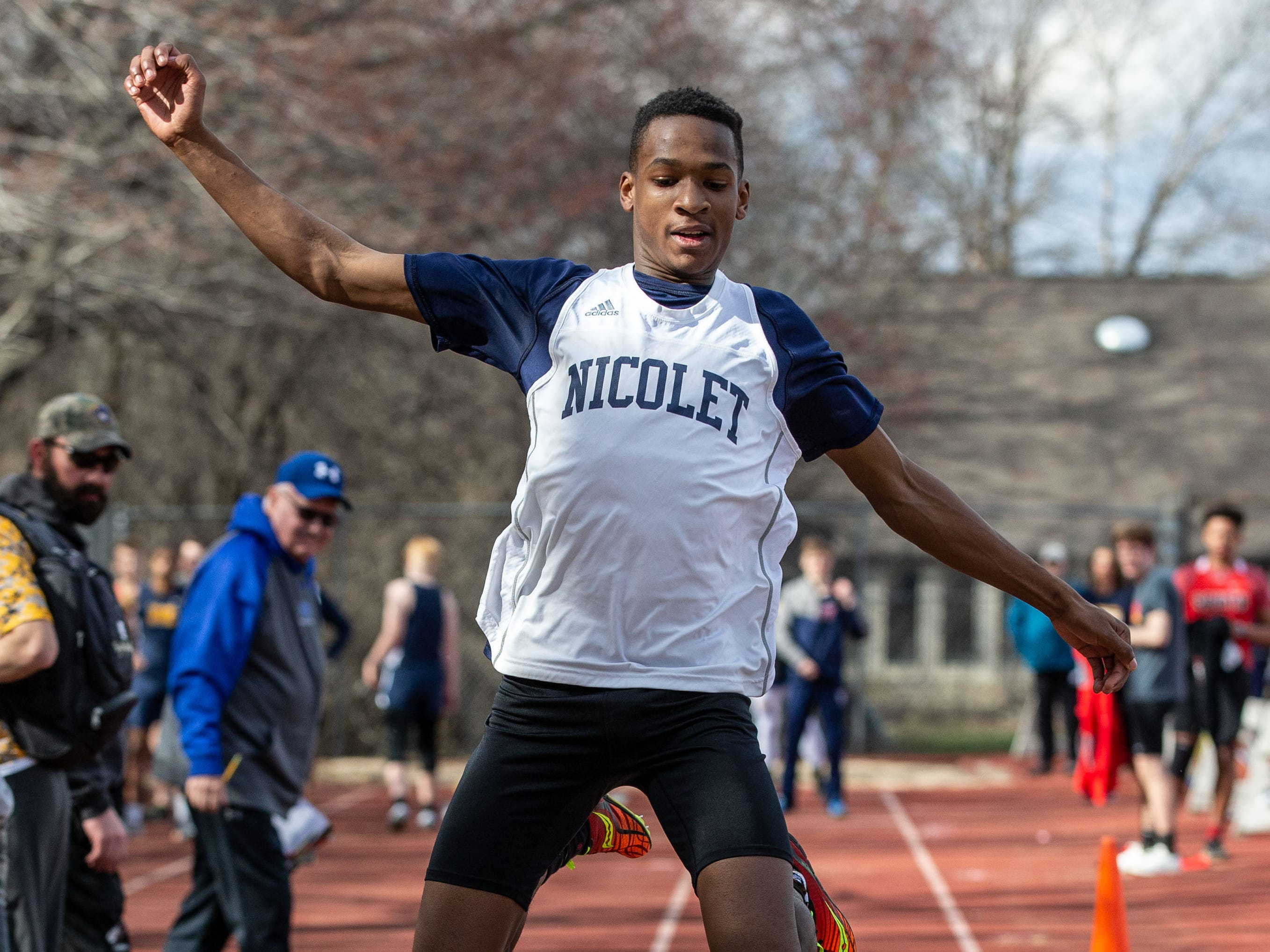 Nicolet's Jeremy Kobe competes in the triple jump during the Mike Gain 50th Annual Spartan Invitational at Brookfield East on Tuesday, April 9, 2019.