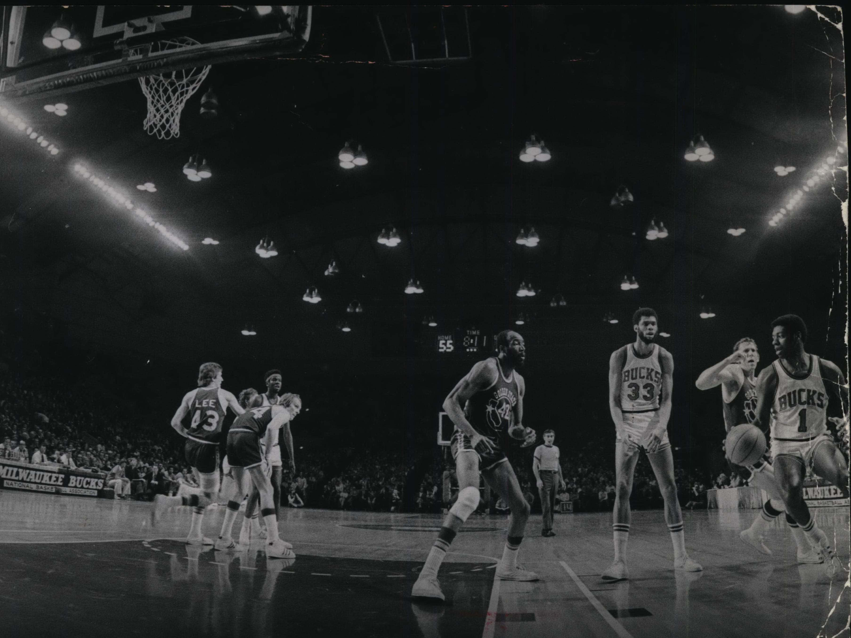 1973: Oscar Robertson (at right) drives toward the basket as the Bucks take on the Golden State Warriors in Game 1 of the NBA playoffs at a packed Milwaukee Arena on March 30, 1973. On the court at the time were four future Basketball Hall of Famers: Robertson, Golden State's Rick Barry (far left) and Nate Thurmond (center) and Kareem Abdul-Jabbar. The Bucks won, 110-90, but lost the series, 4-2. This photo was published in the March 31, 1973, Milwaukee Journal.