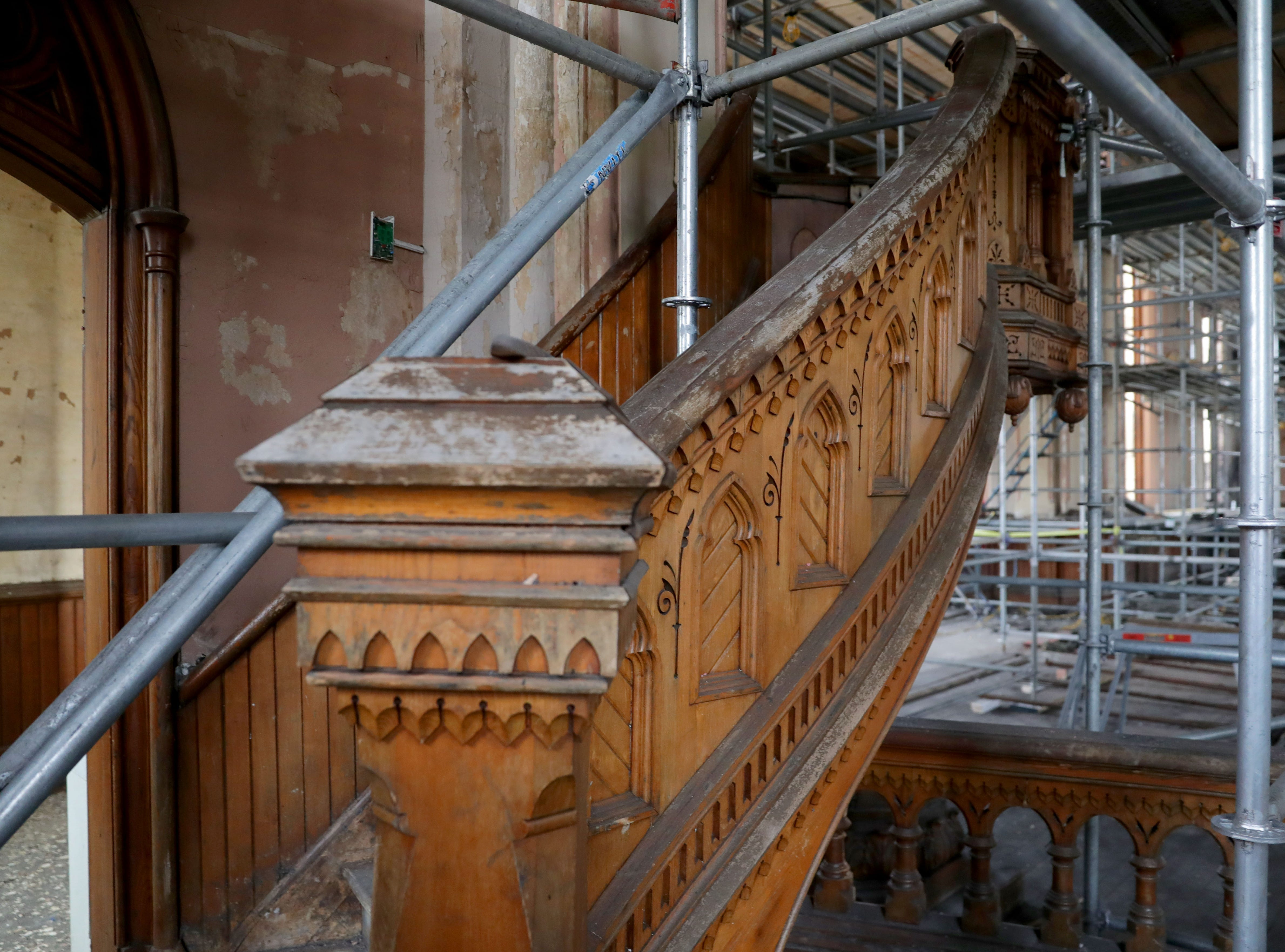 A stairway leading to a pulpit is surrounded in scaffolding at Trinity Evangelical Lutheran Church.