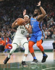 Tim Frazier looks for a path around Oklahoma City's Raymond Felton on Wednesday night. Frazier played all 48 minutes, leading the Bucks with 29 points and 13 assists.