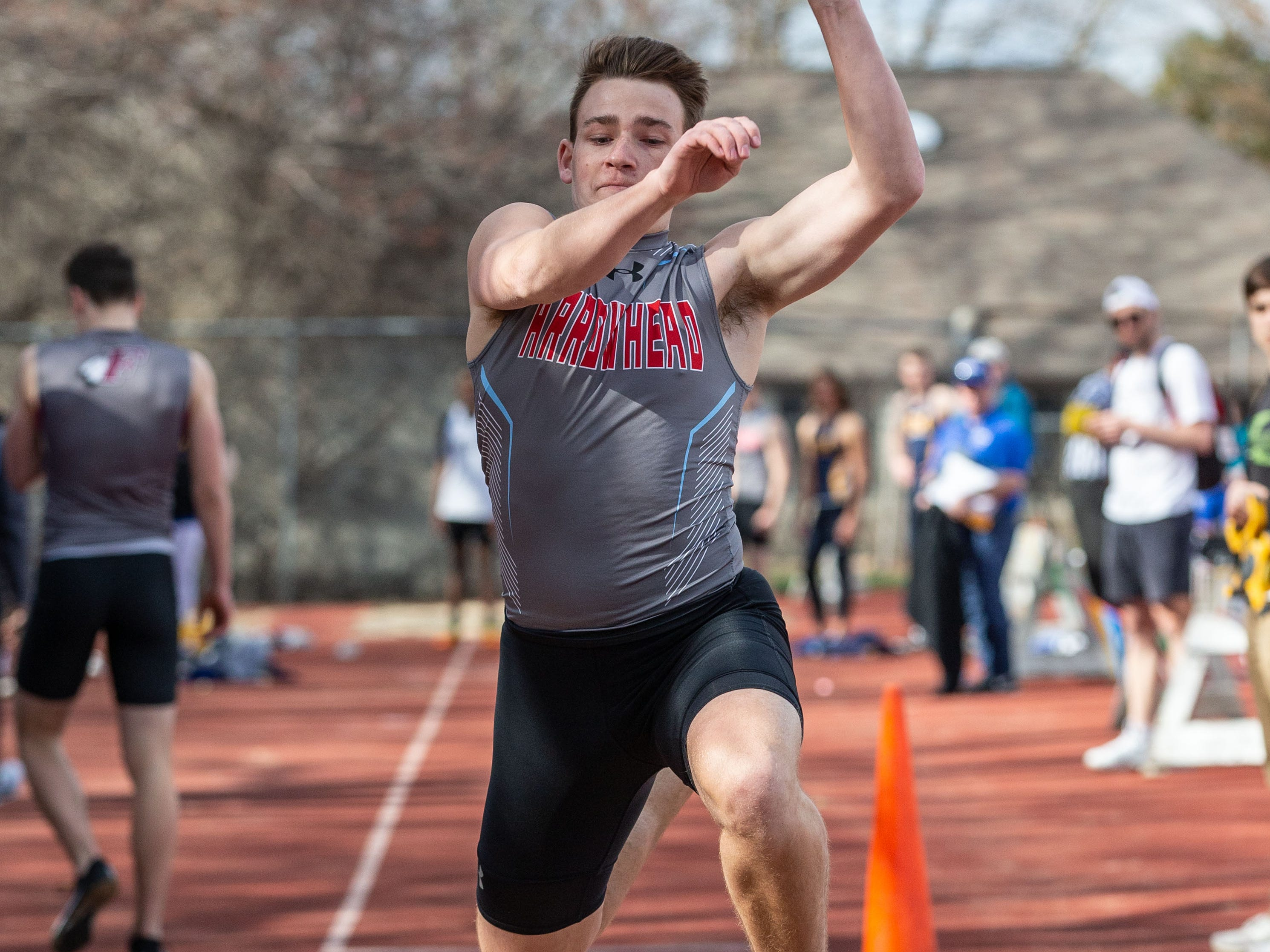 Arrowhead's Alex Peglow competes in the triple jump during the Mike Gain 50th Annual Spartan Invitational at Brookfield East on Tuesday, April 9, 2019.