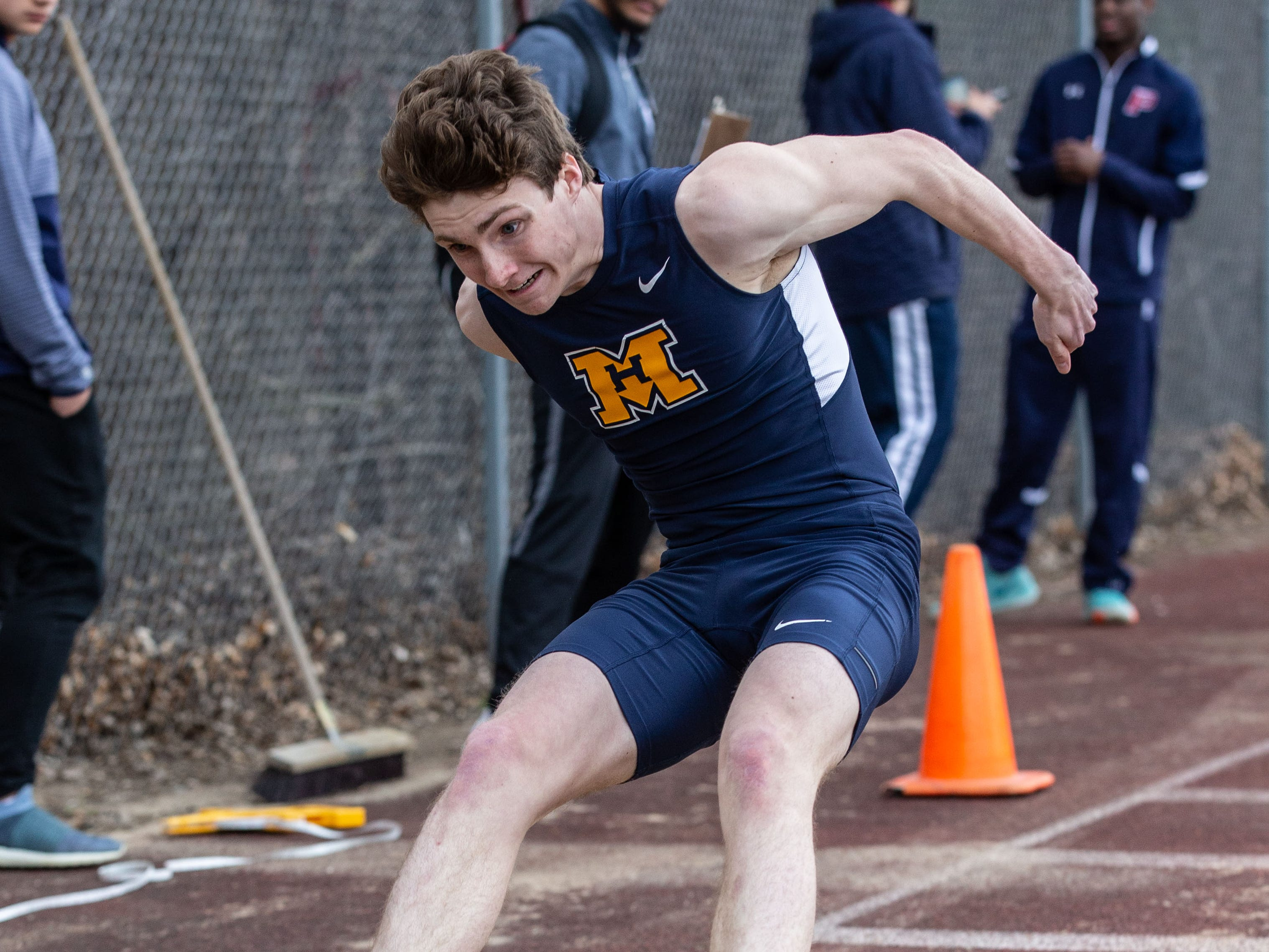 Marquette's Liam Martel competes in the long jump during the Mike Gain 50th Annual Spartan Invitational at Brookfield East on Tuesday, April 9, 2019.