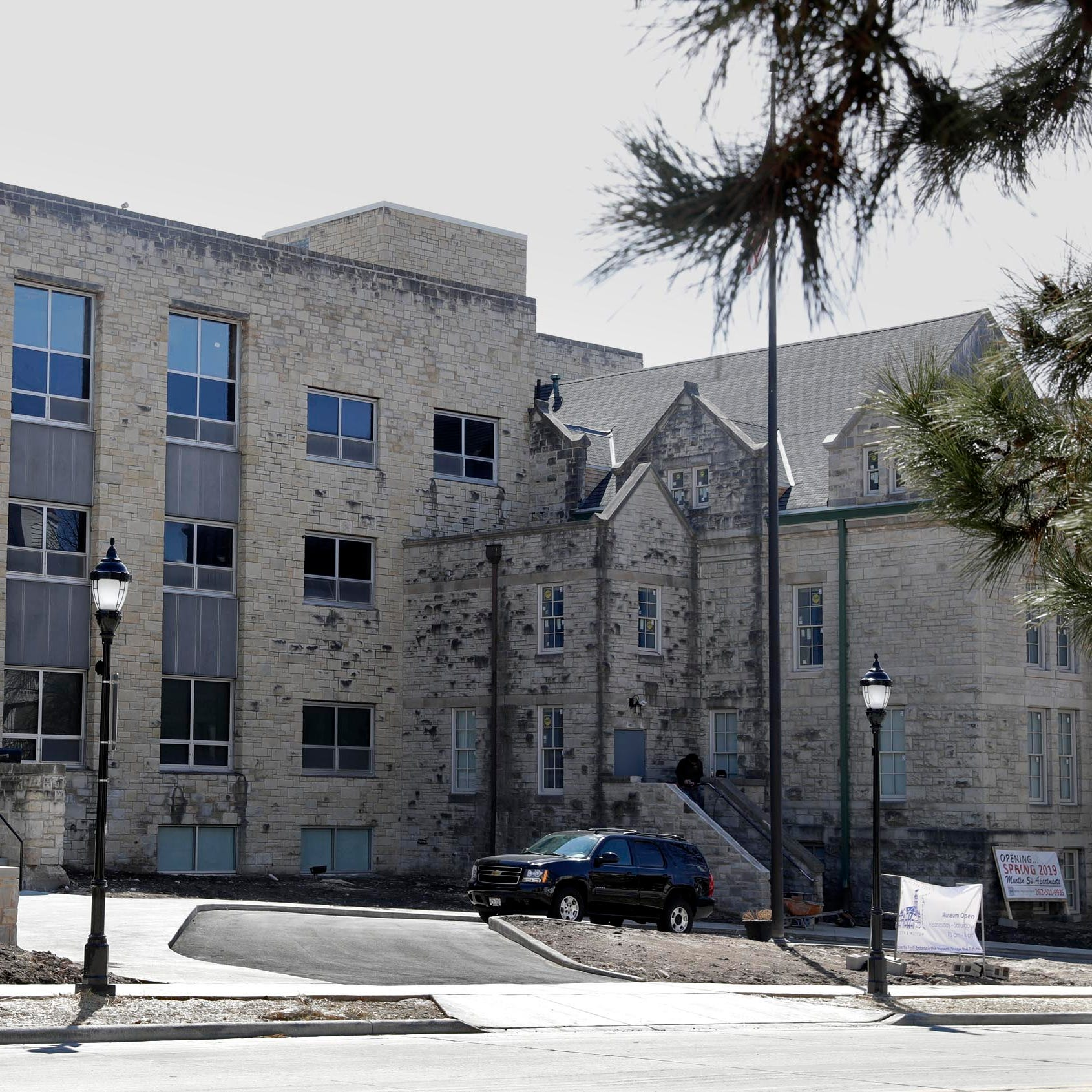 This historic building once served as Waukesha County's jail. Now it's opening new upscale apartments.