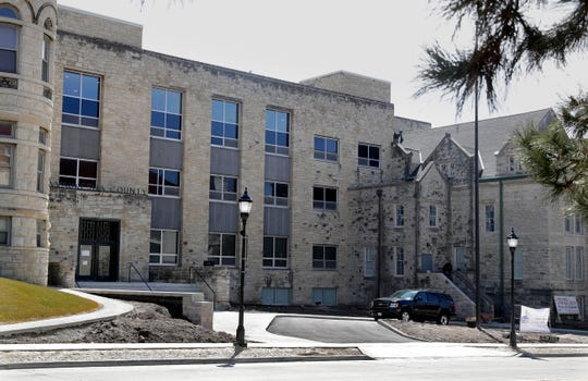 The former Waukesha County jail and a building that connects it to the former Waukesha County Courthouse are being remodeled into apartments.