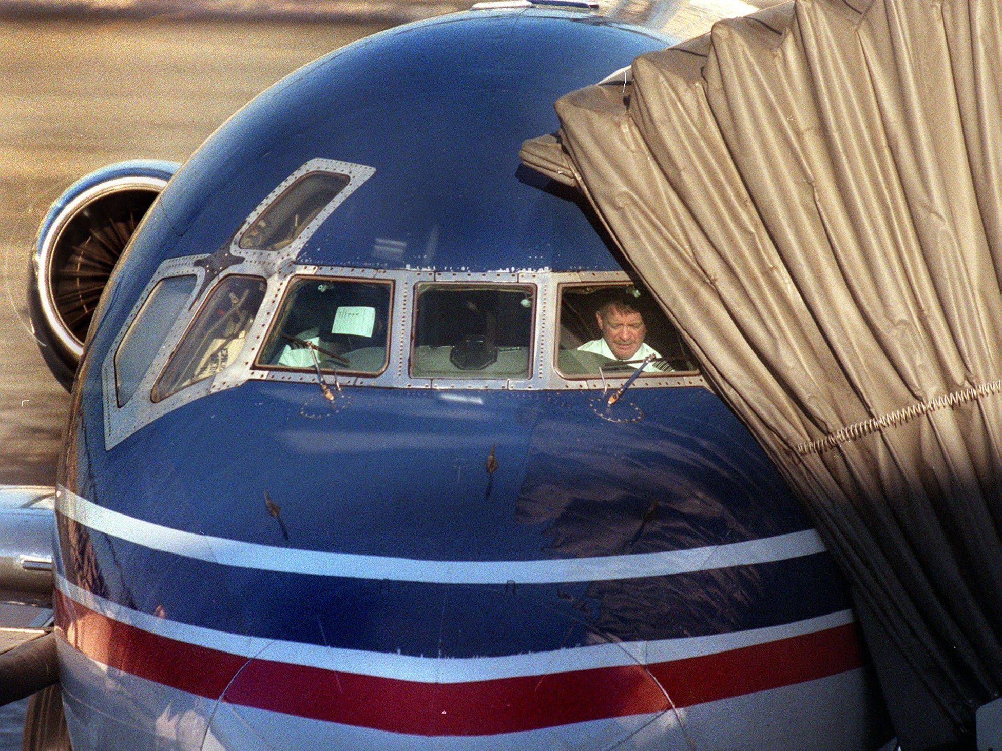 A Midwest Express pilot bound for Hartford goes through his preflight checklist at Mitchell International Saturday morning, February 12, 2000. Last minute talks between Midwest Express and the pilots resulted in a tentative agreement averting a strike.