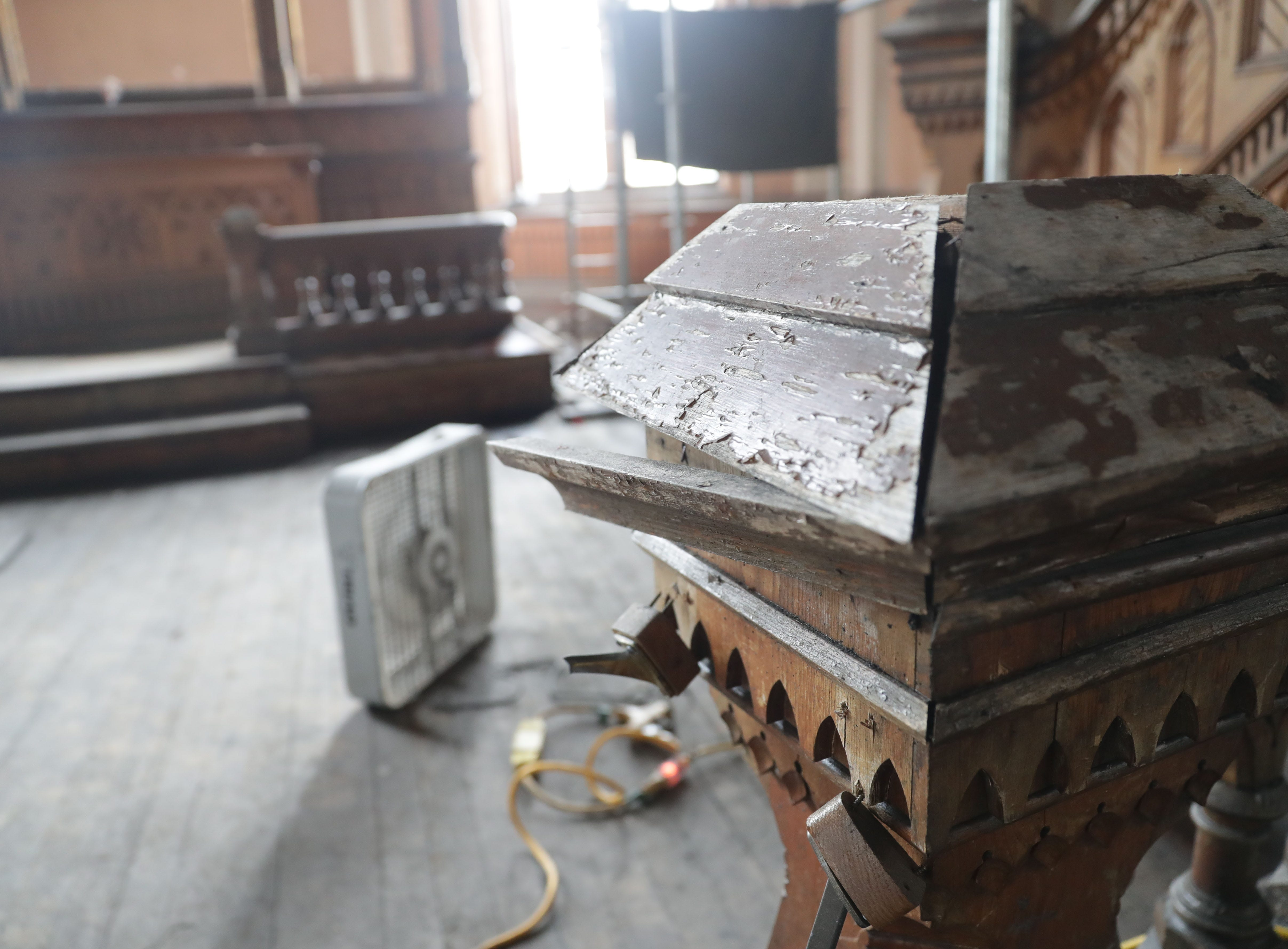 Damaged woodwork is seen near the altar area at Trinity Evangelical Lutheran Church.