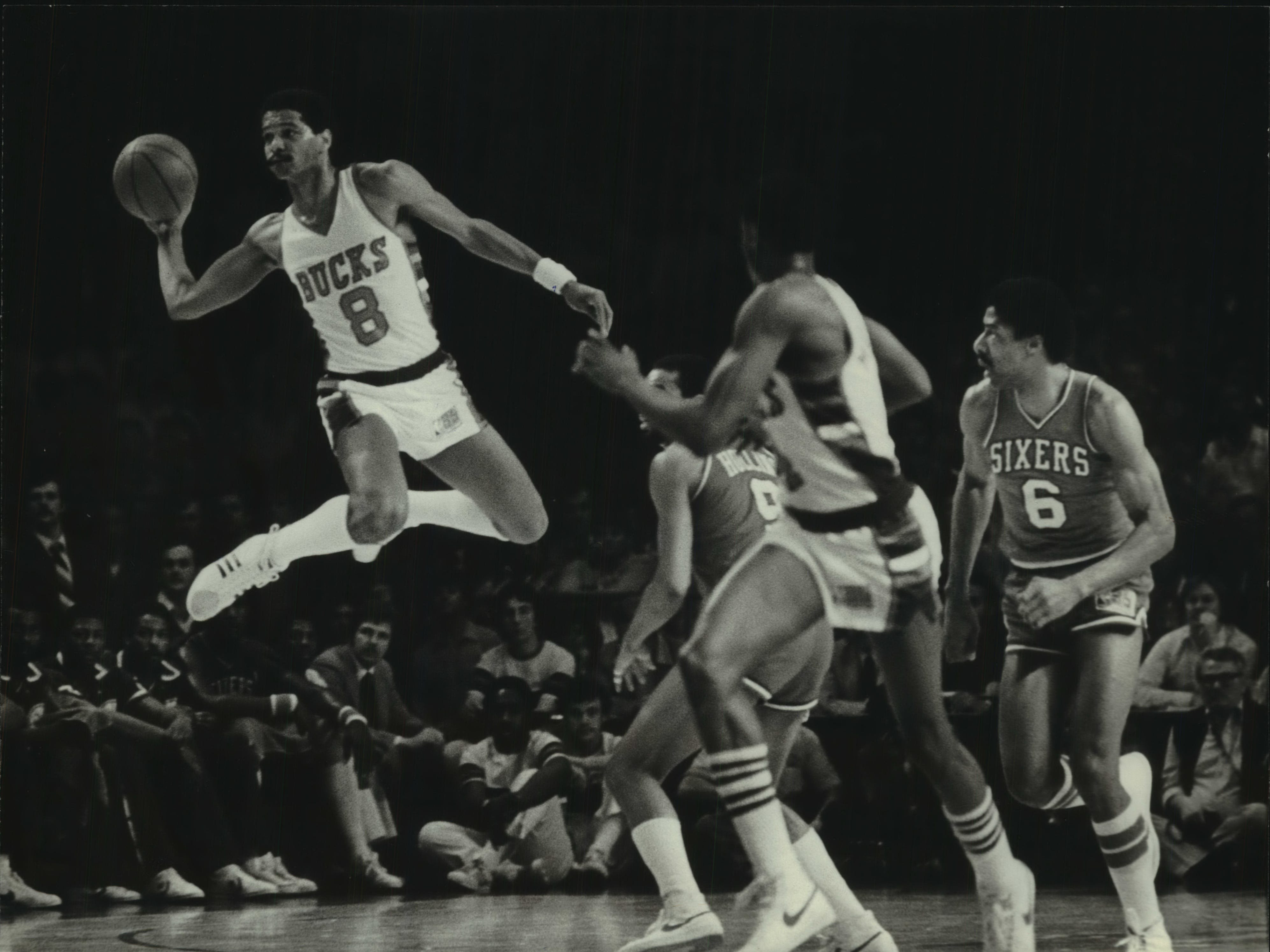 1981: After stealing the ball, Bucks star Marques Johnson fires a long pass to start a fast break against the Philadelphia 76ers during the sixth game of the Eastern Conference semifinals at the Milwaukee Arena on April 17, 1981. That's 76ers star Julius Erving at the far right. The Bucks beat the 76ers 109-86, but lost the series. This photo was published in the April 18, 1981, Milwaukee Sentinel.