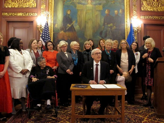 Wisconsin Gov. Tony Evers is surrounded by some of the most powerful women in state government after he signs a proclamation recognizing the 100th anniversary of Wisconsin being the first state to ratify the 19th Amendment which gave women the right to vote on Thursday, April 11, 2019. Those with Evers included Wisconsin Supreme Court Chief Justice Pat Roggensack, Justice Shirley Abrahamson and a number of state lawmakers.