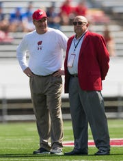 Wisconsin athletic director Barry Alvarez (right) will answer fans' questions before football practice Saturday, and coach Paul Chryst will speak to fans after practice.