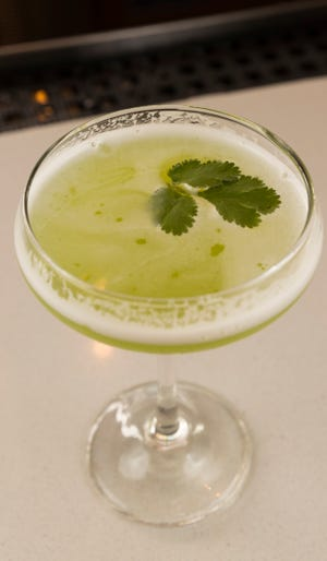 It looks like a regular cocktail, but the cilantro fizz is one of the nonalcoholic drinks at Punch Bowl Social downtown.