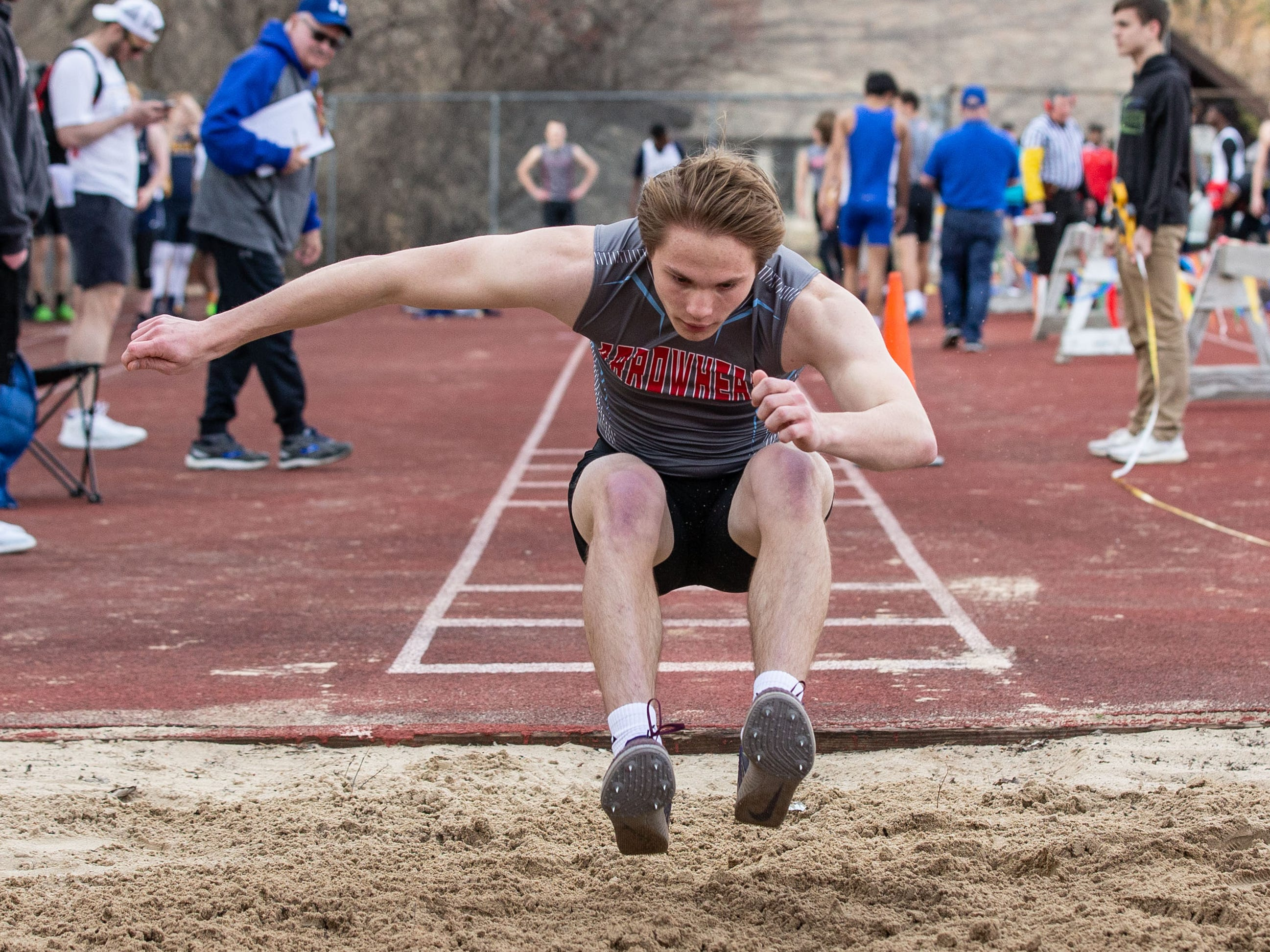 Arrowhead's Ryan Burchett competes in the triple jump during the Mike Gain 50th Annual Spartan Invitational at Brookfield East on Tuesday, April 9, 2019. Burchett placed second with a jump of 39-00.75.