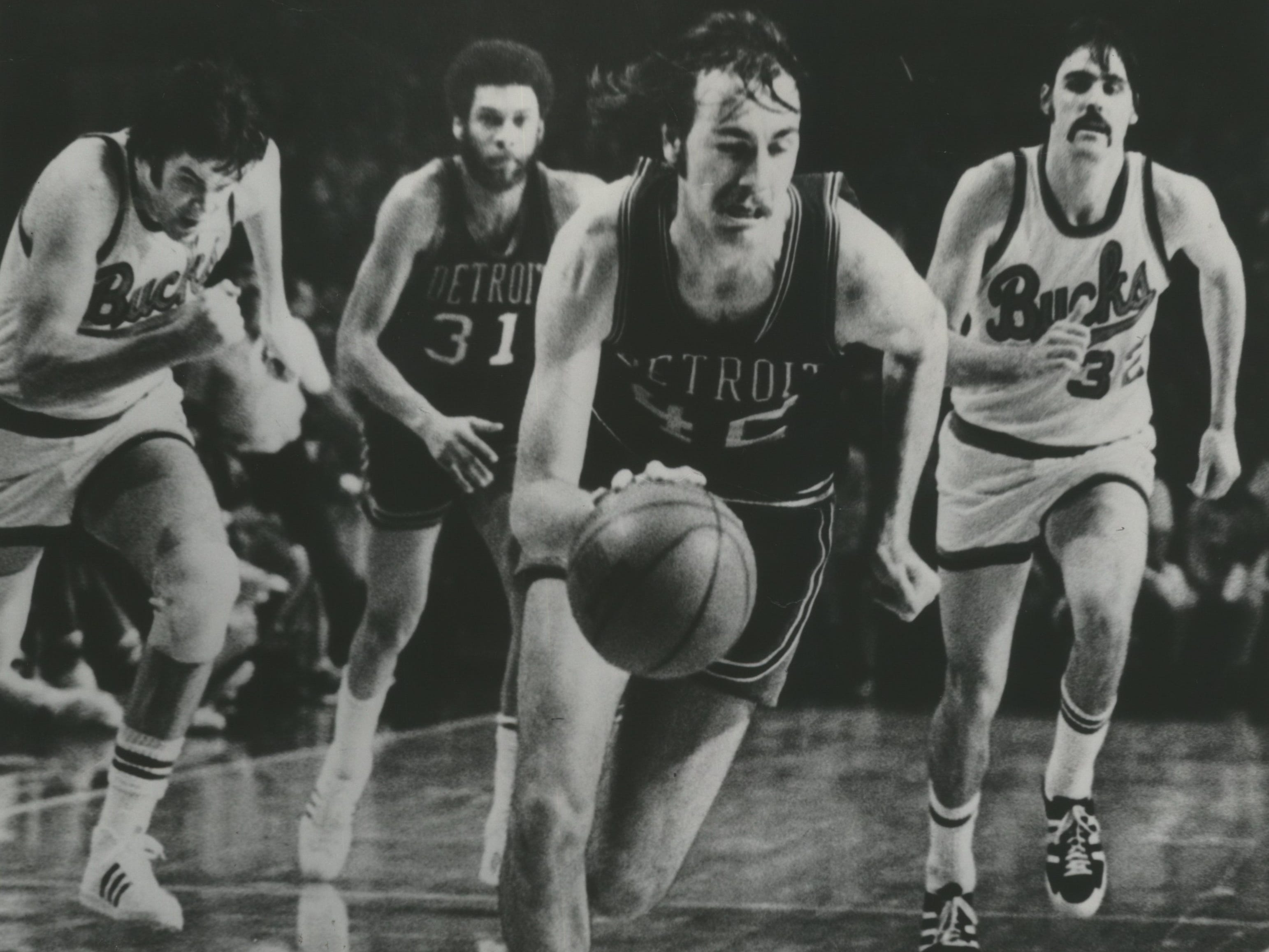 1976: Detroit's Chris Ford steals the inbound pass and takes the ball downcourt, as Bucks Dave Meyers (left) and Brian Winters (right) give chase in a key moment at the end of Game 3 of the first round of the 1976 Western Conference playoffs on April 18, 1976. The Pistons' 107-104 victory eliminated the Bucks from the playoffs. This photo was published in the April 19, 1976, Milwaukee Sentinel.