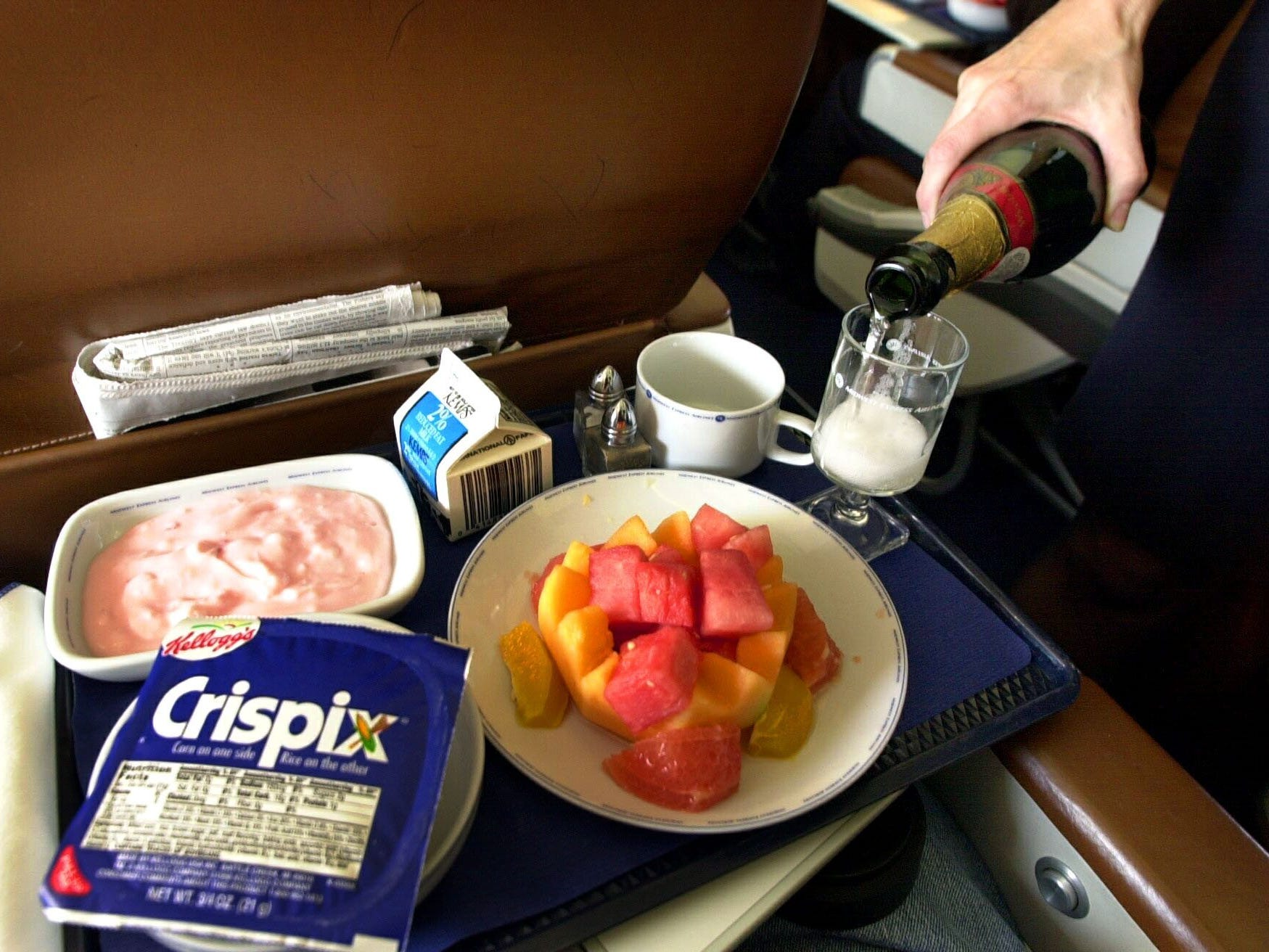 Excellant meals with complimentary wine or champagne is served on Midwest Express Airlines February 23, 2000.