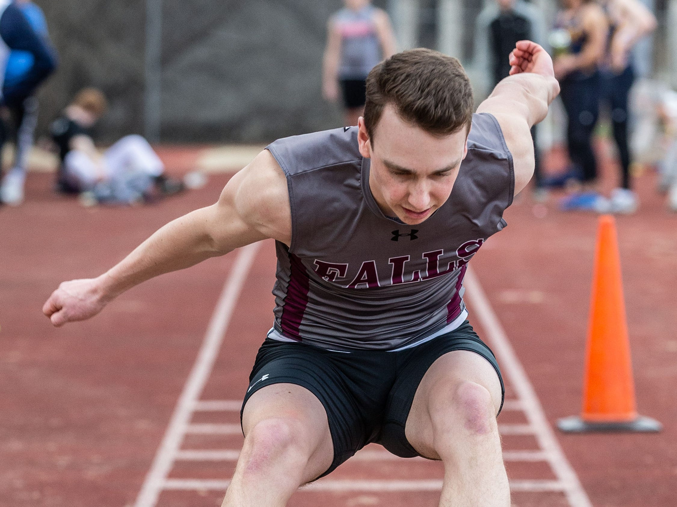 Menomonee Falls' Charlie Pomroy competes in the triple jump during the Mike Gain 50th Annual Spartan Invitational at Brookfield East on Tuesday, April 9, 2019.