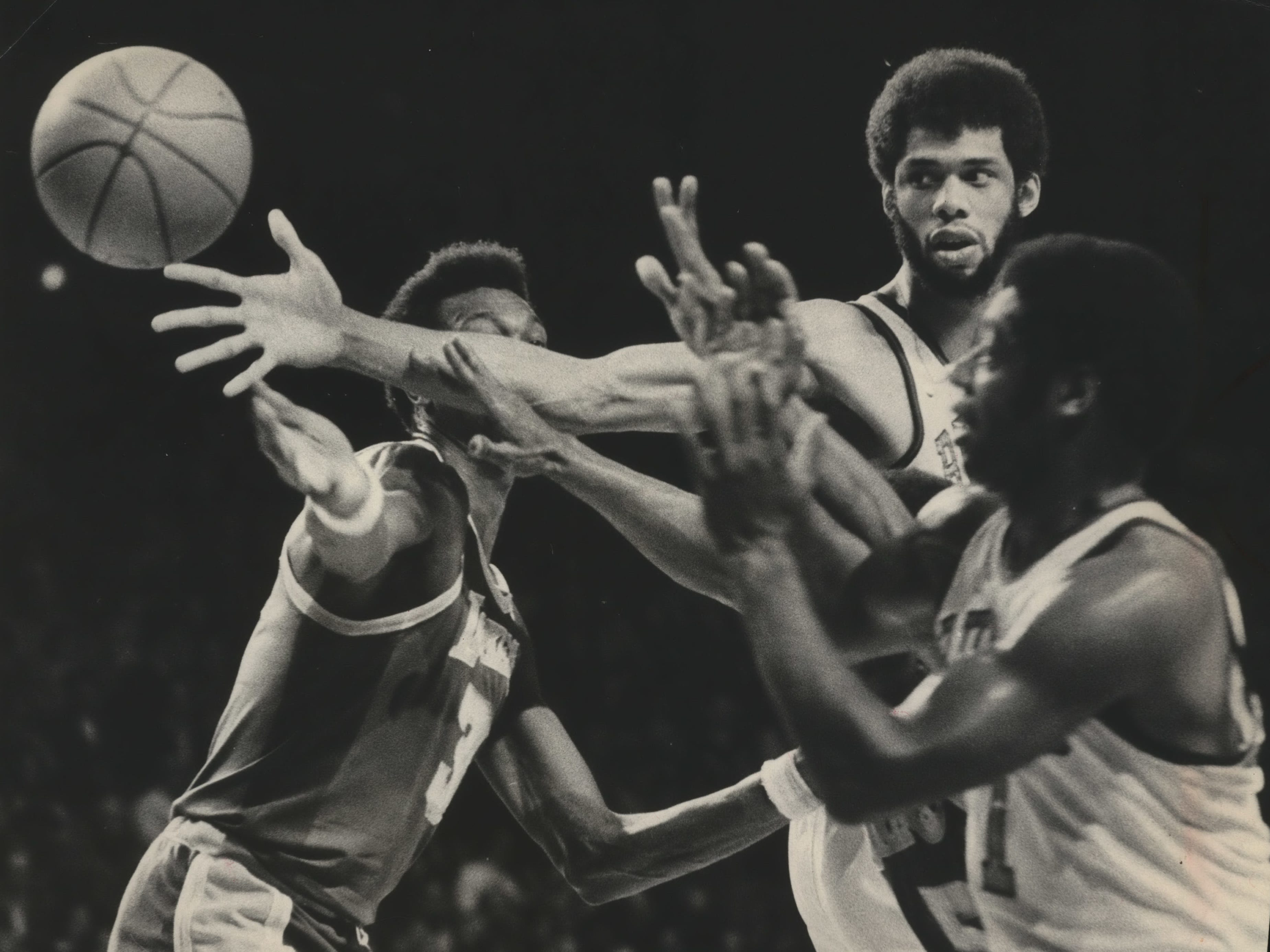 Kareem Abdul-Jabbar reaches for the ball past Los Angeles' Elmore Smith and Bucks guard Oscar Robertson during the  Game 5 of the first round of the NBA playoffs on April 7, 1974. Milwaukee beat the Lakers, 114-92, and won the series. The Bucks won the Western Conference title but lost the NBA finals in seven games to the Boston Celtics. This photo was published in the April 8, 1974, Milwaukee Sentinel.