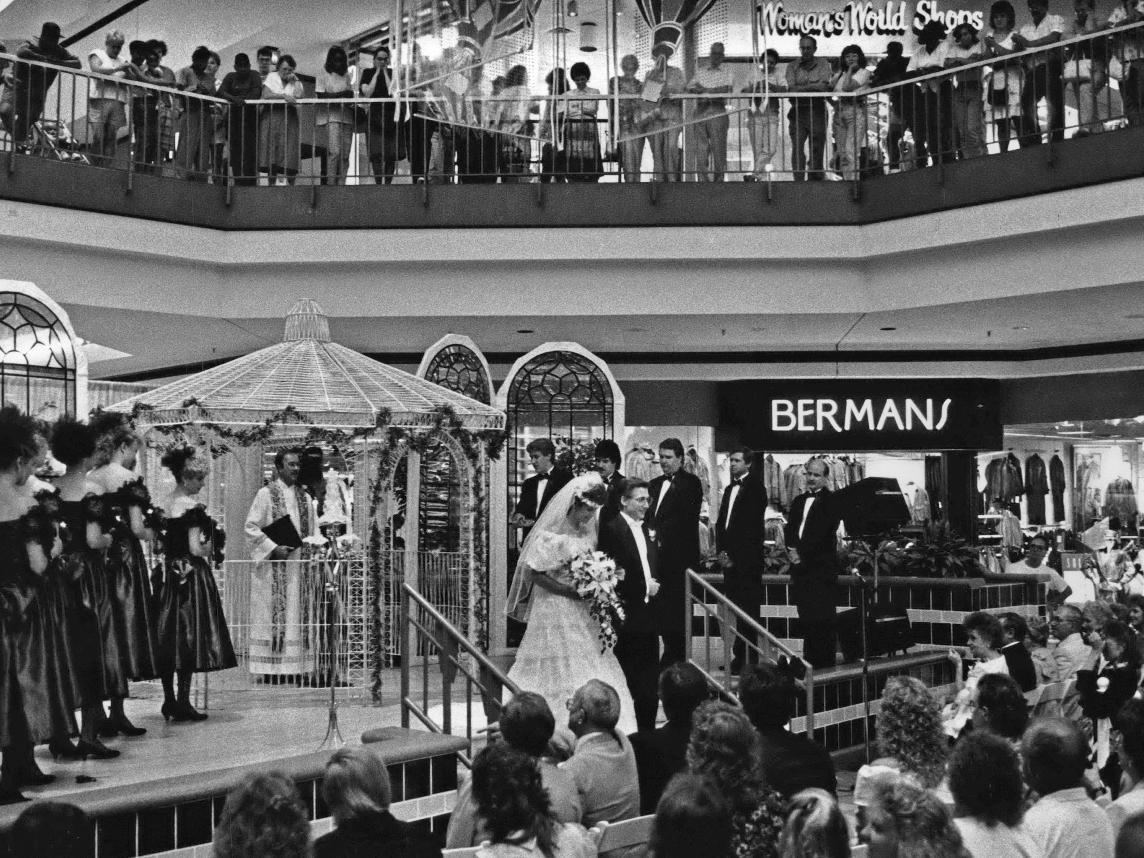 July 1990: Carina Tenant and Ron Geis, of Menomonee Falls, walk down the aisle at Northridge Shopping Center after their wedding on the Center Court Stage. The couple was selected from those applying for the wedding at a bridal fair in February at the center.