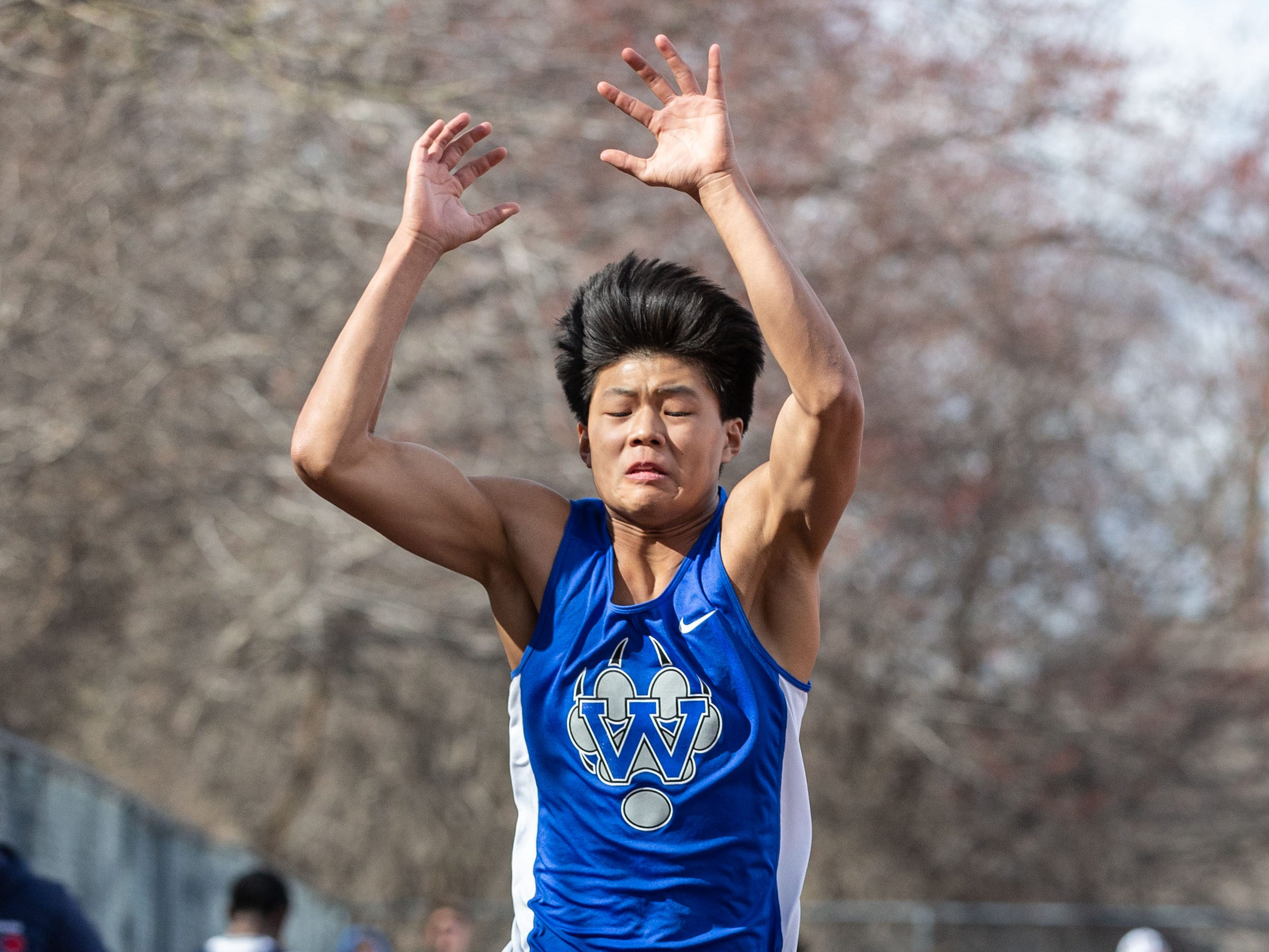 Waukesha West's Kyle Miller competes in the long jump during the Mike Gain 50th Annual Spartan Invitational at Brookfield East on Tuesday, April 9, 2019.