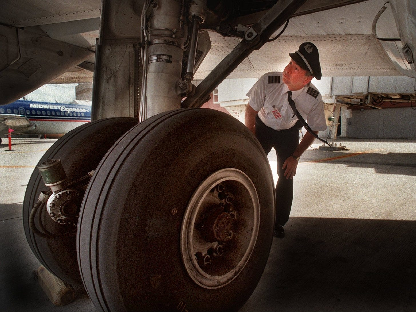 Midwest Expres Airlines pilot Michael R. Jilot inspects his aircraft prior to departing for Cleveland.