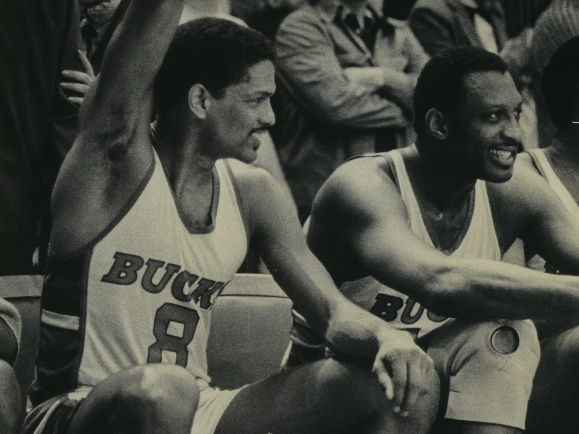 1983: Marques Johnson (waving a towel)  and Bob Lanier savor the moment near the end of the Bucks' playoff victory over the Boston Celtics at the Milwaukee Arena, 107-93, on May 2, 1983. The Bucks swept the Celtics in the Eastern Conference Semifinals, only to lose in the conference finals to the Philadelphia 76ers. This photo was published in the May 3, 1983, Milwaukee Sentinel.